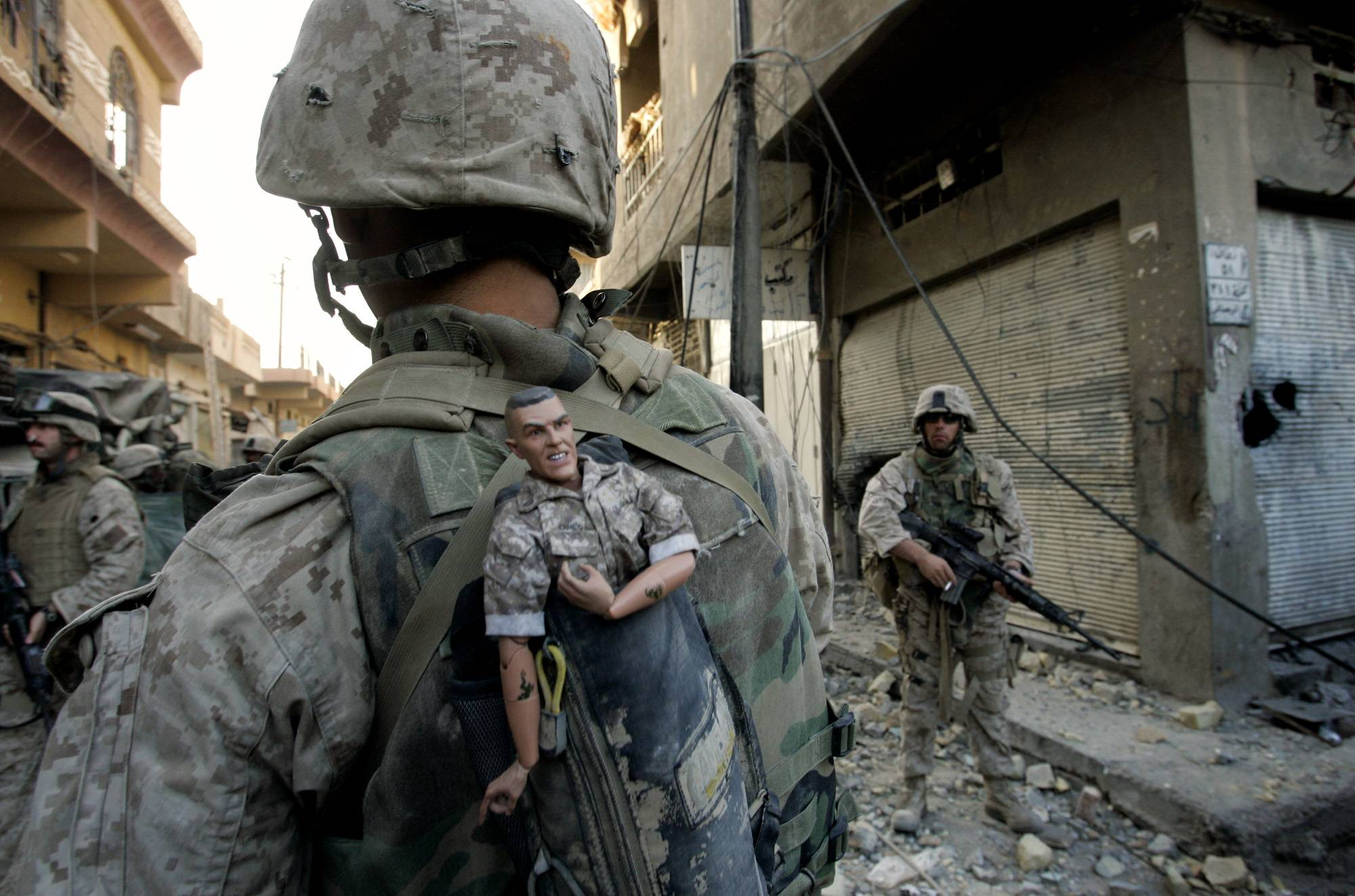 In Sunday, Nov. 14, 2004 file photo made by Associated Press photographer Anja Niedringhaus, a U.S. Marine of the 1st Division carries a mascot for good luck in his backpack as his unit pushed further into the western part of Fallujah, Iraq.