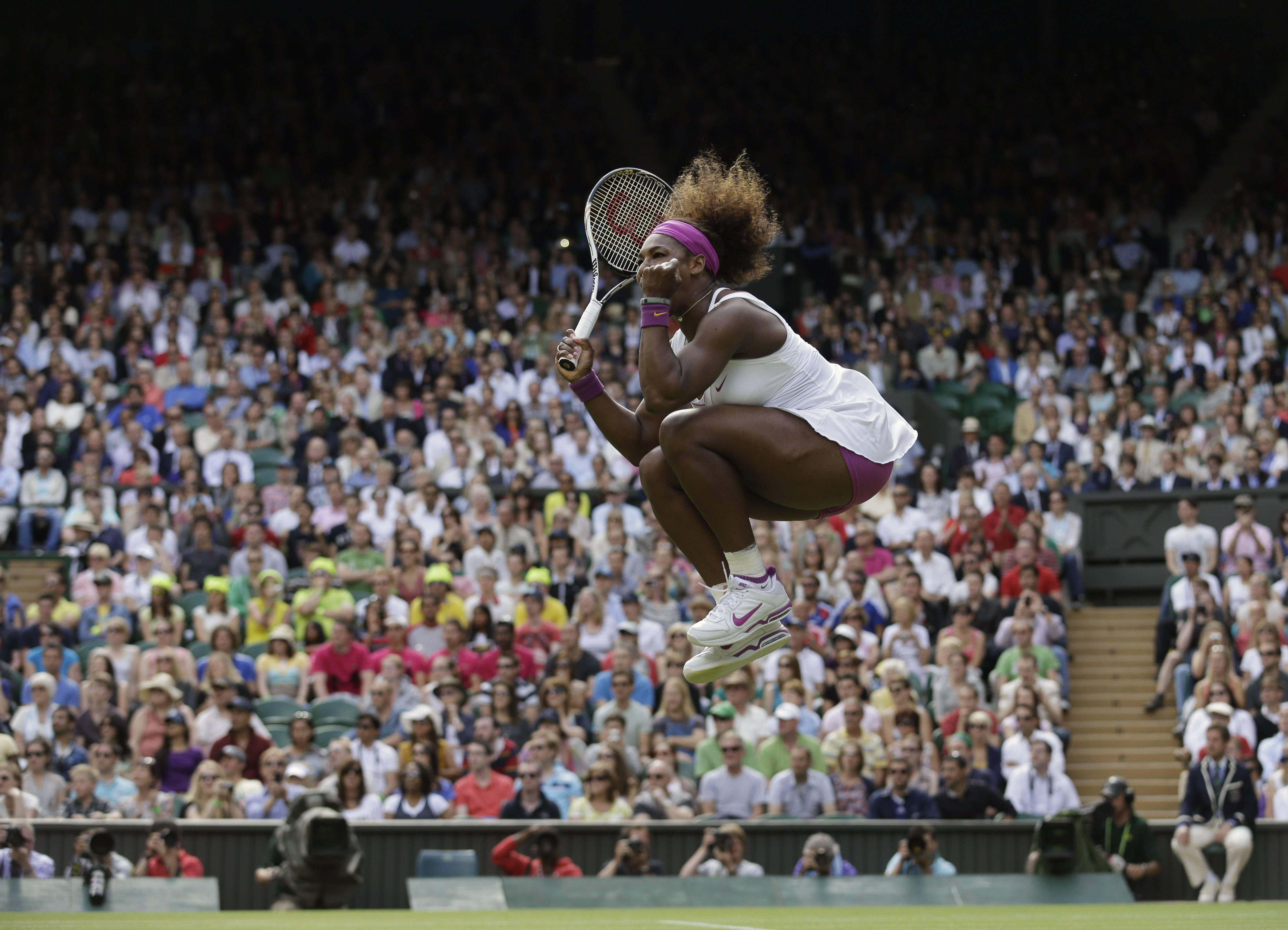 In this Saturday, June 30, 2012 file photo made by Associated Press photographer Anja Niedringhaus, Serena Williams of the United States reacts after winning against Zheng Jie of China during a third round women's singles match at the All England Lawn Tennis Championships at Wimbledon, England.
