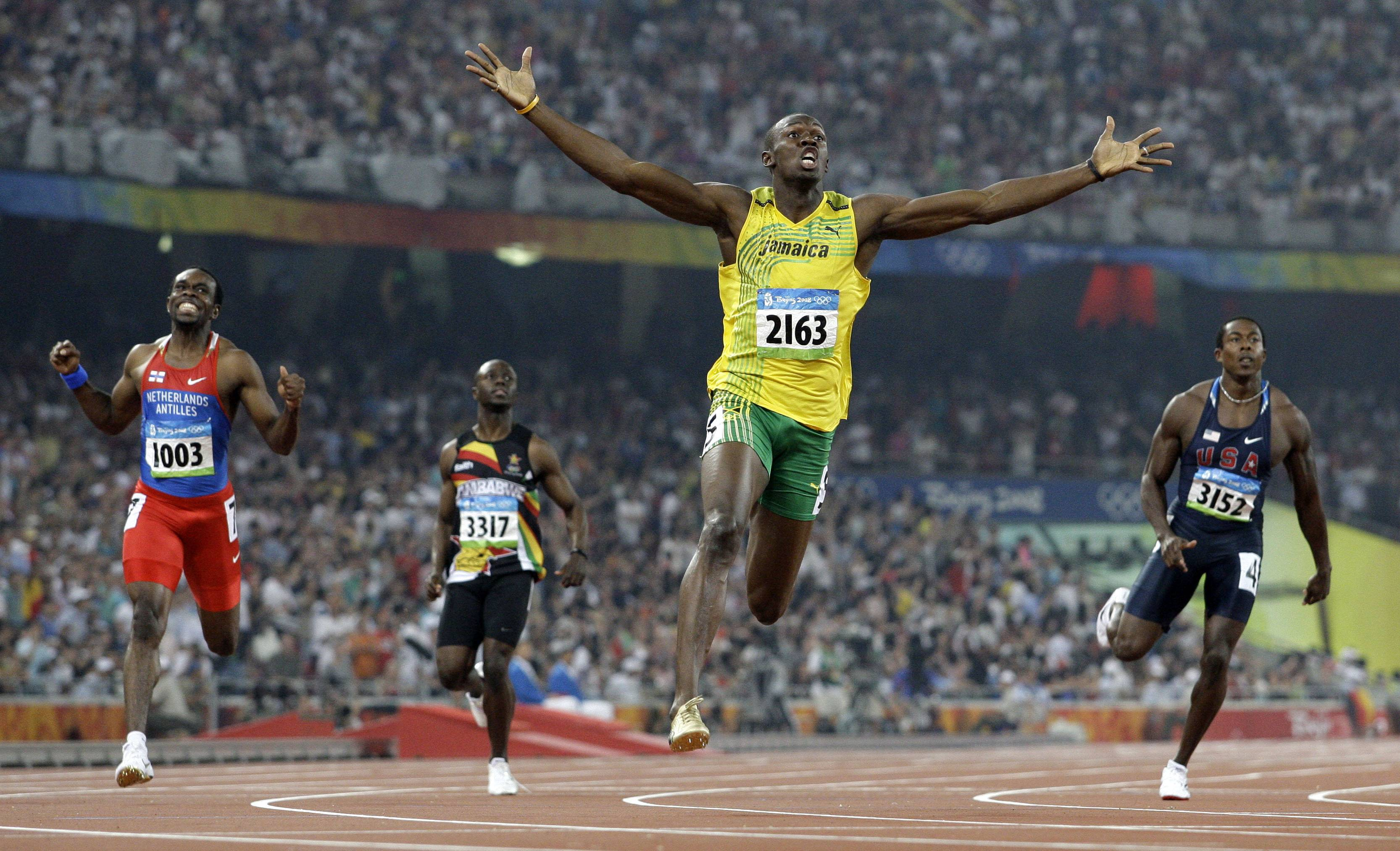 In this Aug. 20, 2008 file photo made by Associated Press photographer Anja Niedringhaus, Jamaica's Usain Bolt crosses the finish line to win the gold in the men's 200-meter final at the Beijing 2008 Olympics in Beijing.