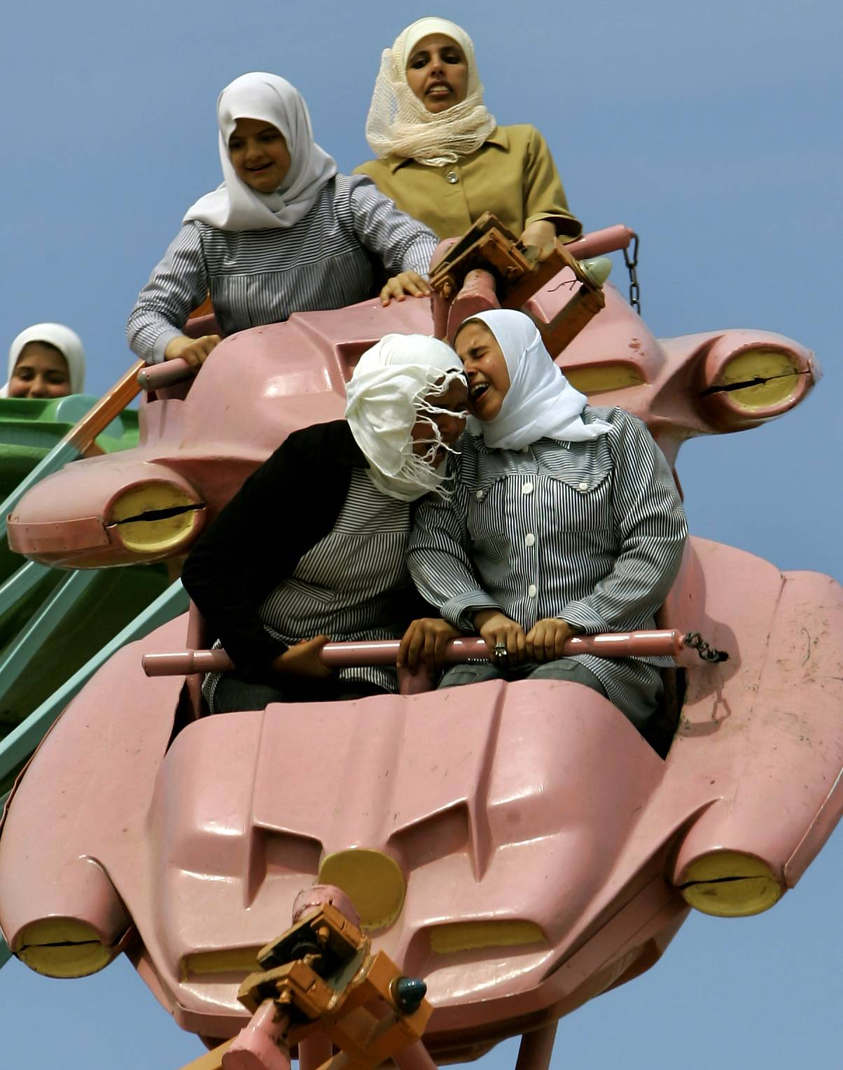 In this Sunday, March 26, 2006 file photo made by Associated Press photographer Anja Niedringhaus, Palestinians enjoy a ride at an amusement park outside Gaza City.
