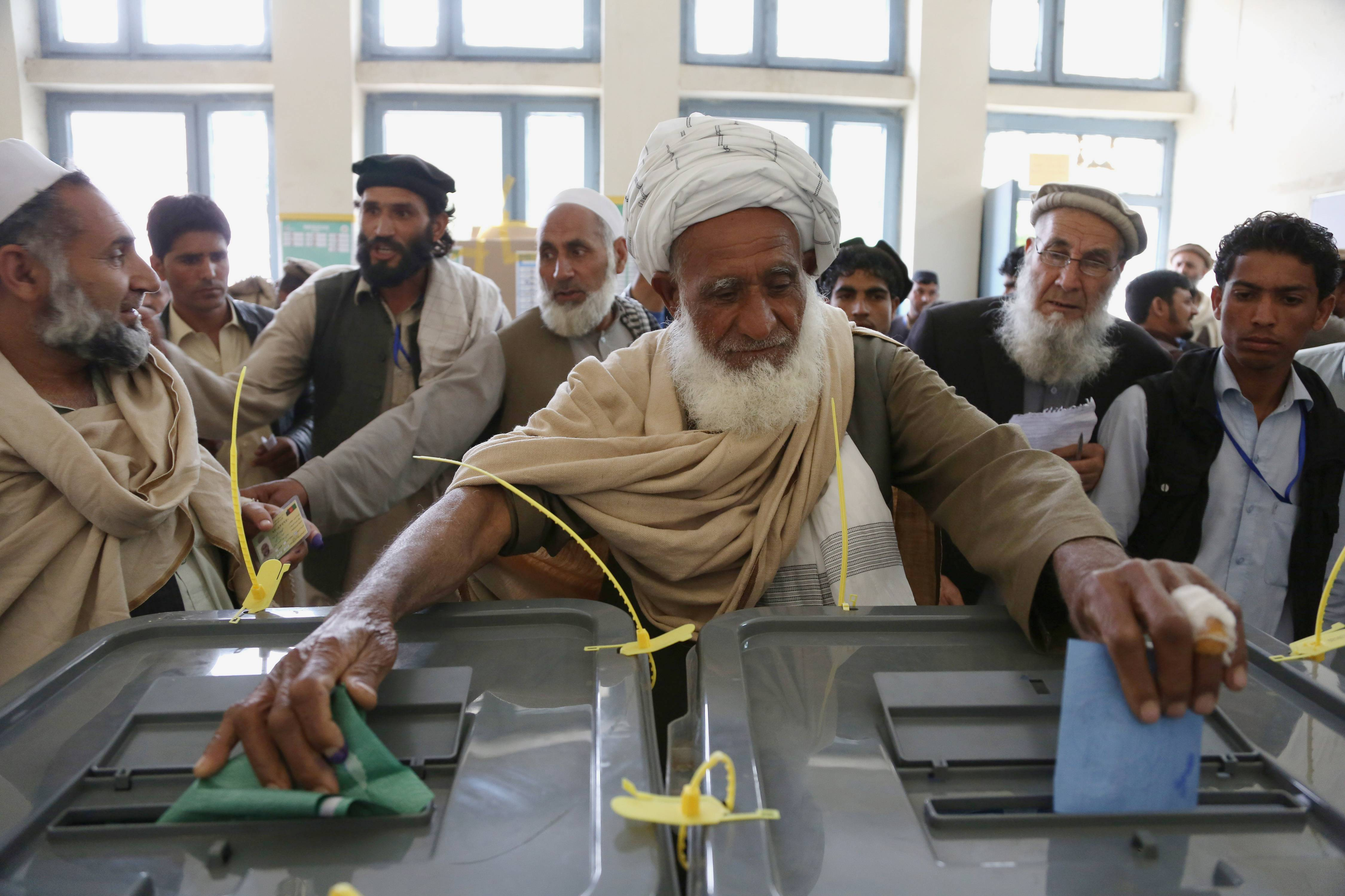 An Afghan man casts his vote at a polling station in Jalalabad, east of Kabul, Afghanistan, Saturday.