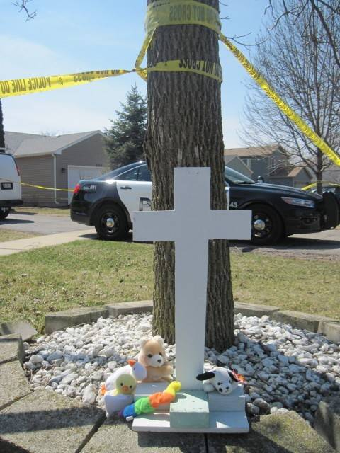 A memorial is erected near the Woodridge home where Zuzanna Bzdek, 3, was killed in a murder-suicide.
