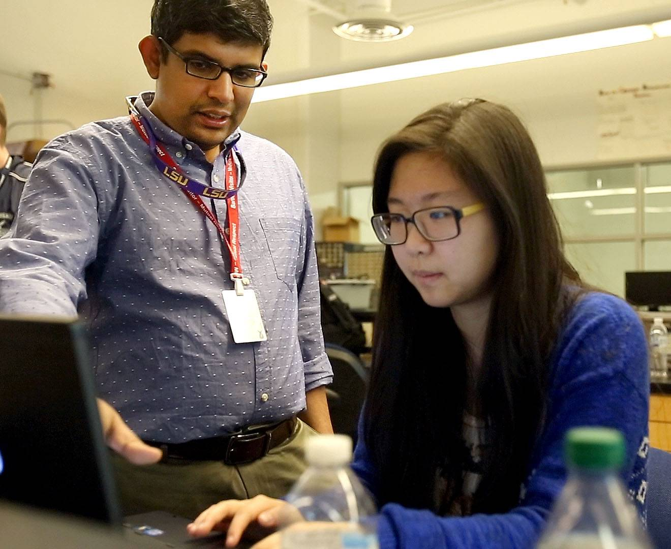 Krishnendu Roy, a math and computer science professor at Valdosta State University in Georgia, helps freshman Autumn Chung. Roy will continue to mentor the students.
