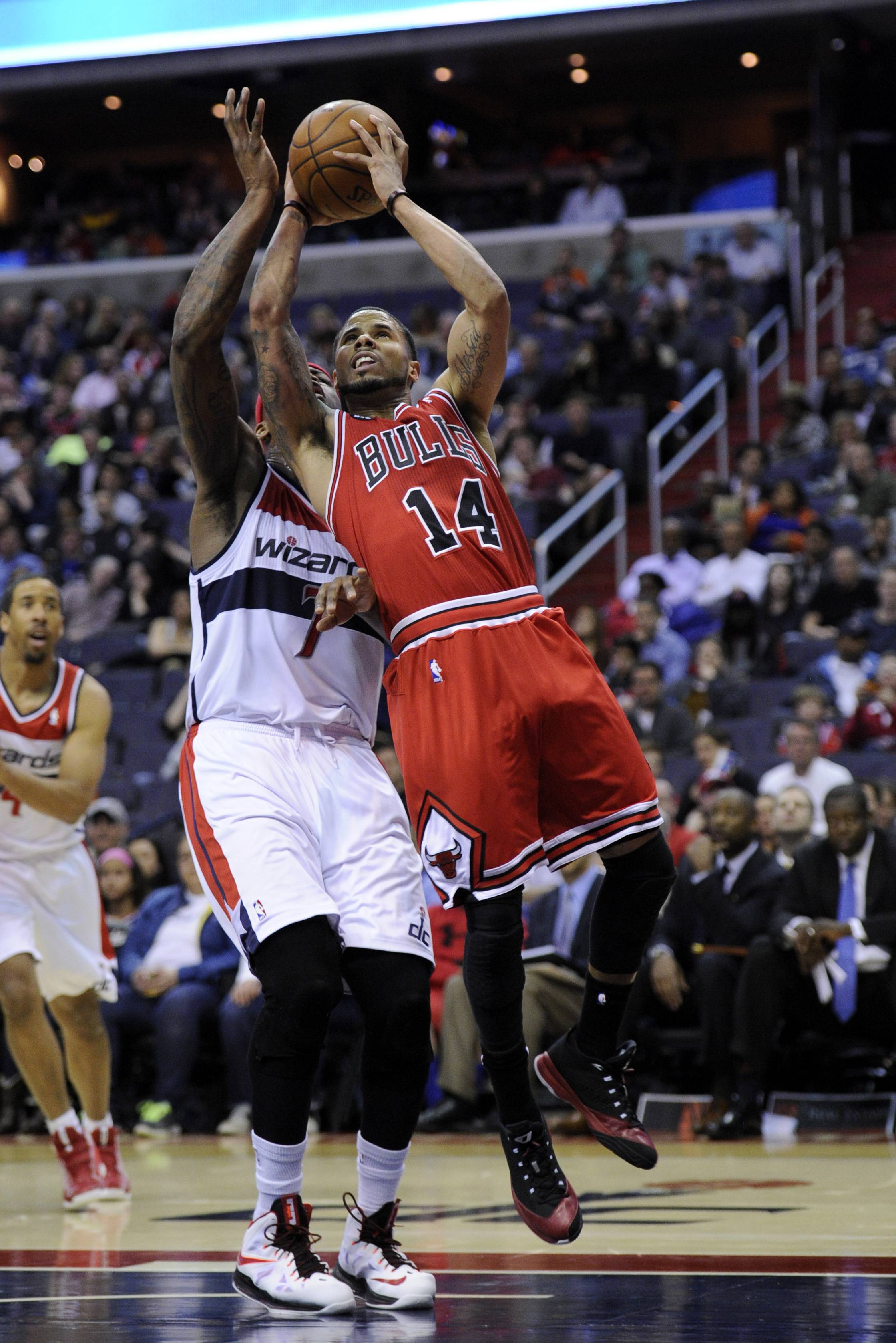 Chicago Bulls guard D.J. Augustin (14) goes to the basket against Washington Wizards forward Al Harrington (7) during Saturday's game in Washington. Augustin scored 25 points Saturday night, helping the Bulls to a 96-78 win over the Washington Wizards.