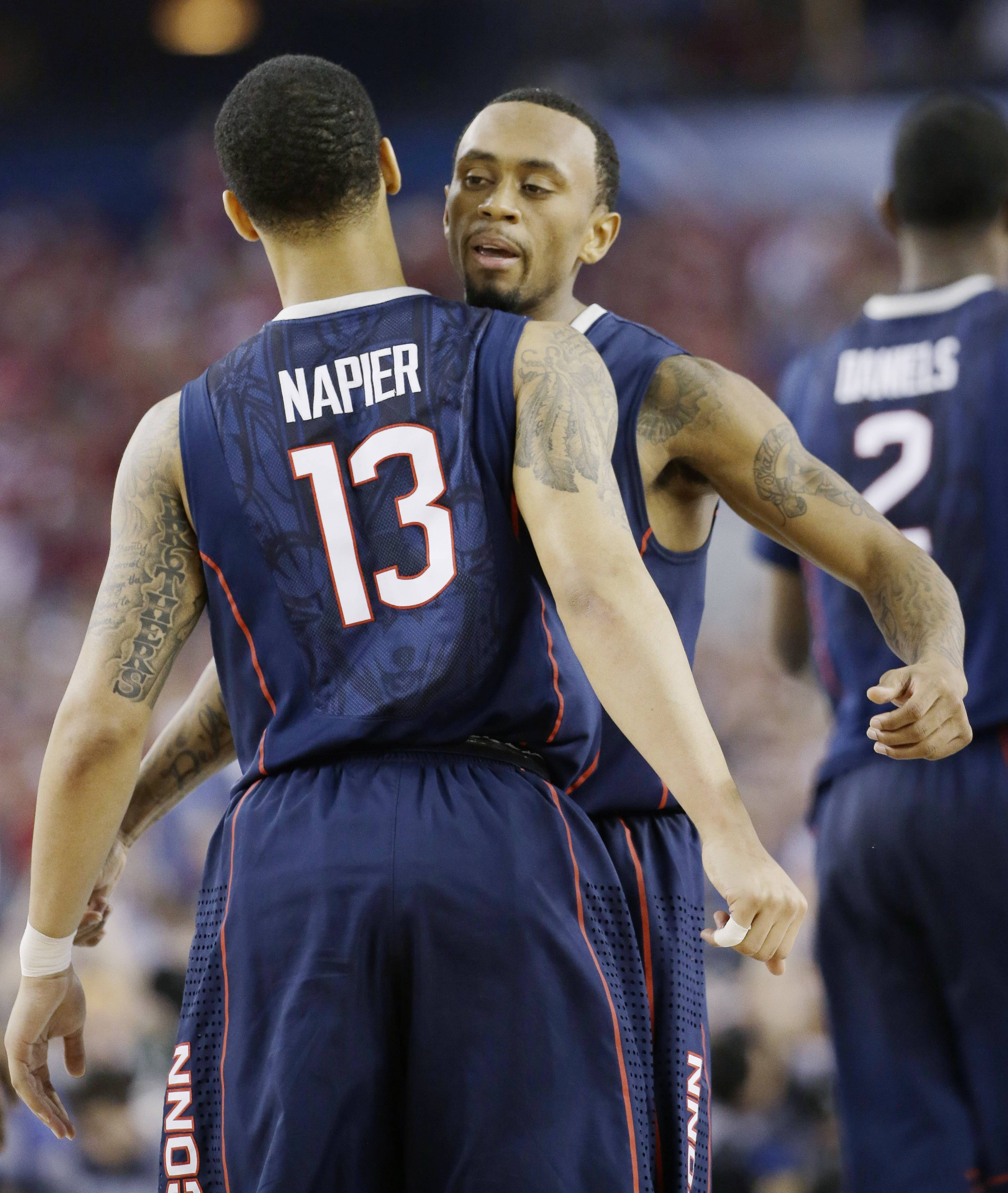 Connecticut guard Shabazz Napier (13) and guard Ryan Boatright celebrate during the NCAA Final Four tournament college basketball semifinal game Saturday in Arlington, Texas.