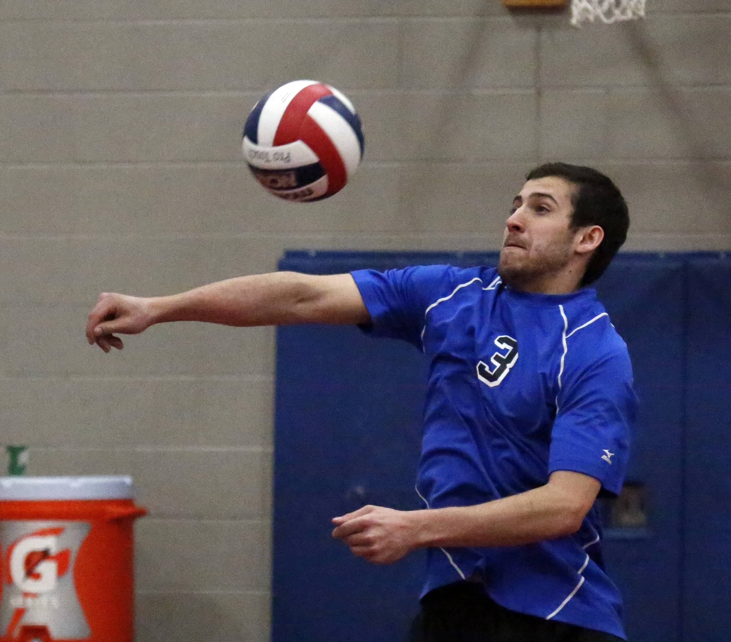 Geneva's Chris Parrilli, 3, during the West Aurora High School boys volleyball invite Saturday in Aurora.