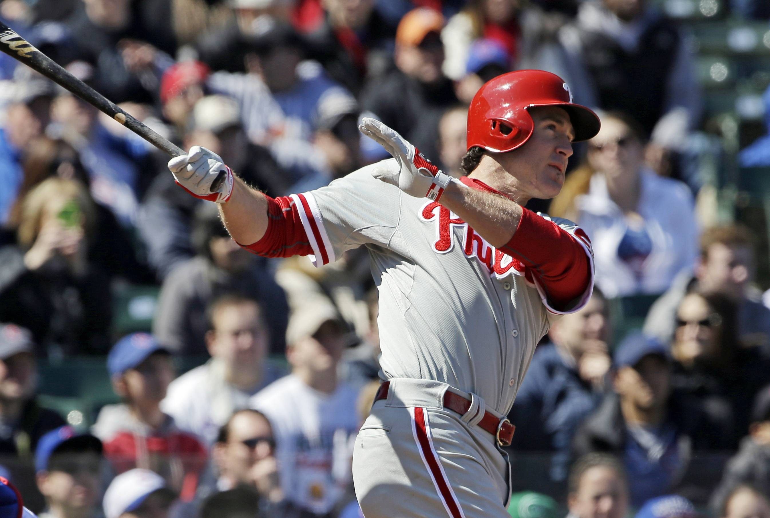 Philadelphia Phillies' Chase Utley watches his solo home run during the first inning of a baseball game against the Chicago Cubs in Chicago, Saturday, April 5, 2014.