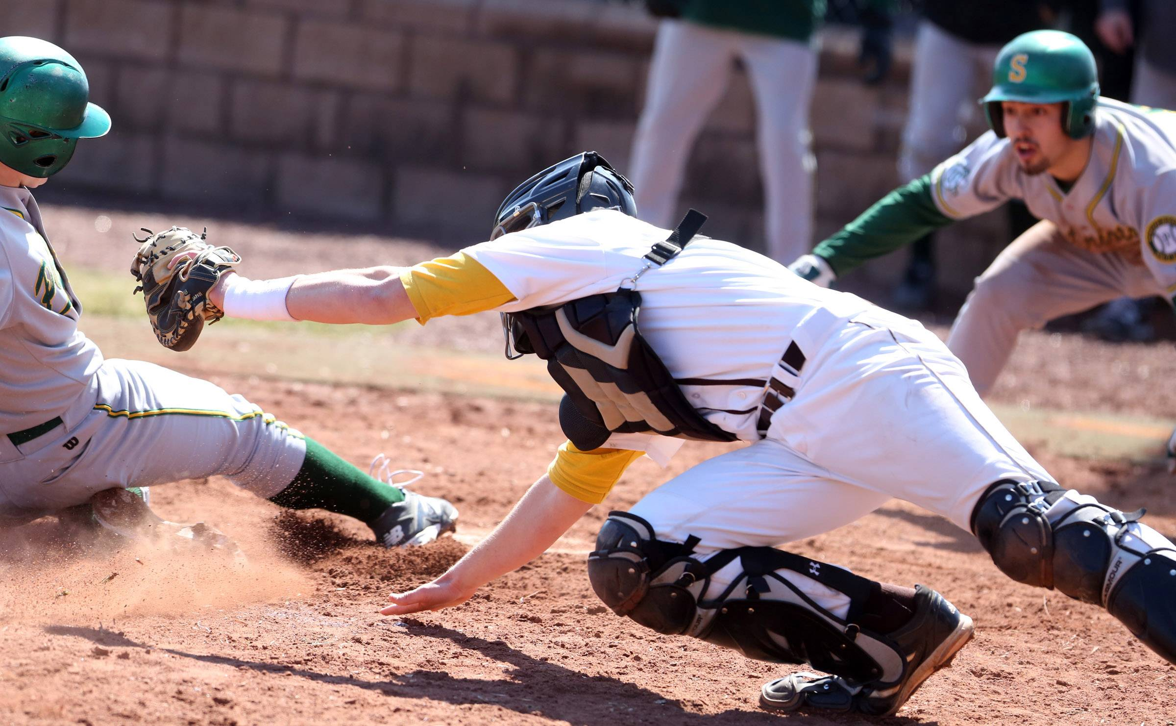Stevenson's Willie Bourbon slides into home plate safe as Carmel catcher Ian Kristan reaches for the tag at Carmel on Saturday in Mundelein.