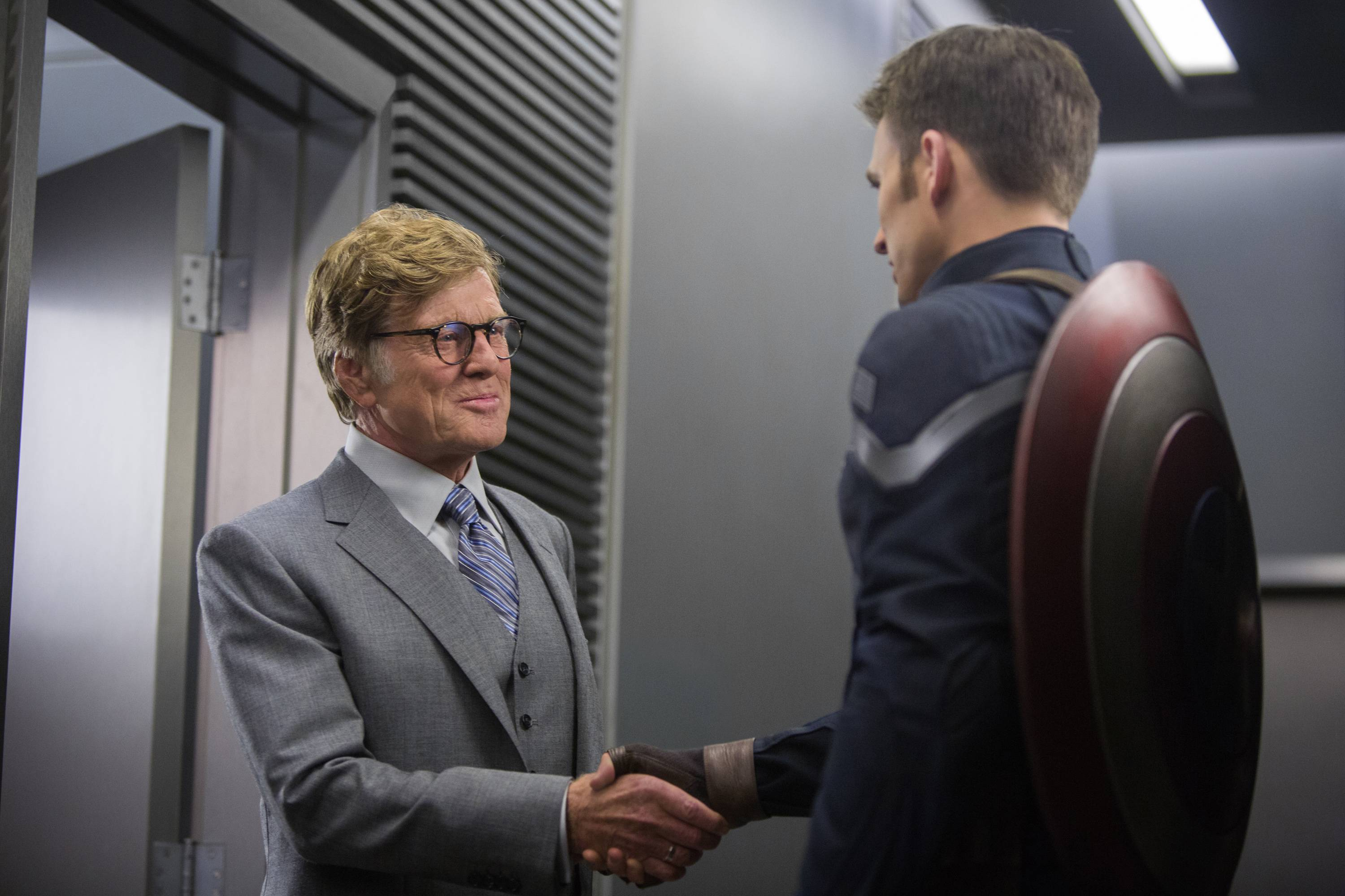 "This image released by Marvel shows Robert Redford, left, and Chris Evans in a scene from ""Captain America: The Winter Soldier,"" which broke an April box office record with a $96 million debut."