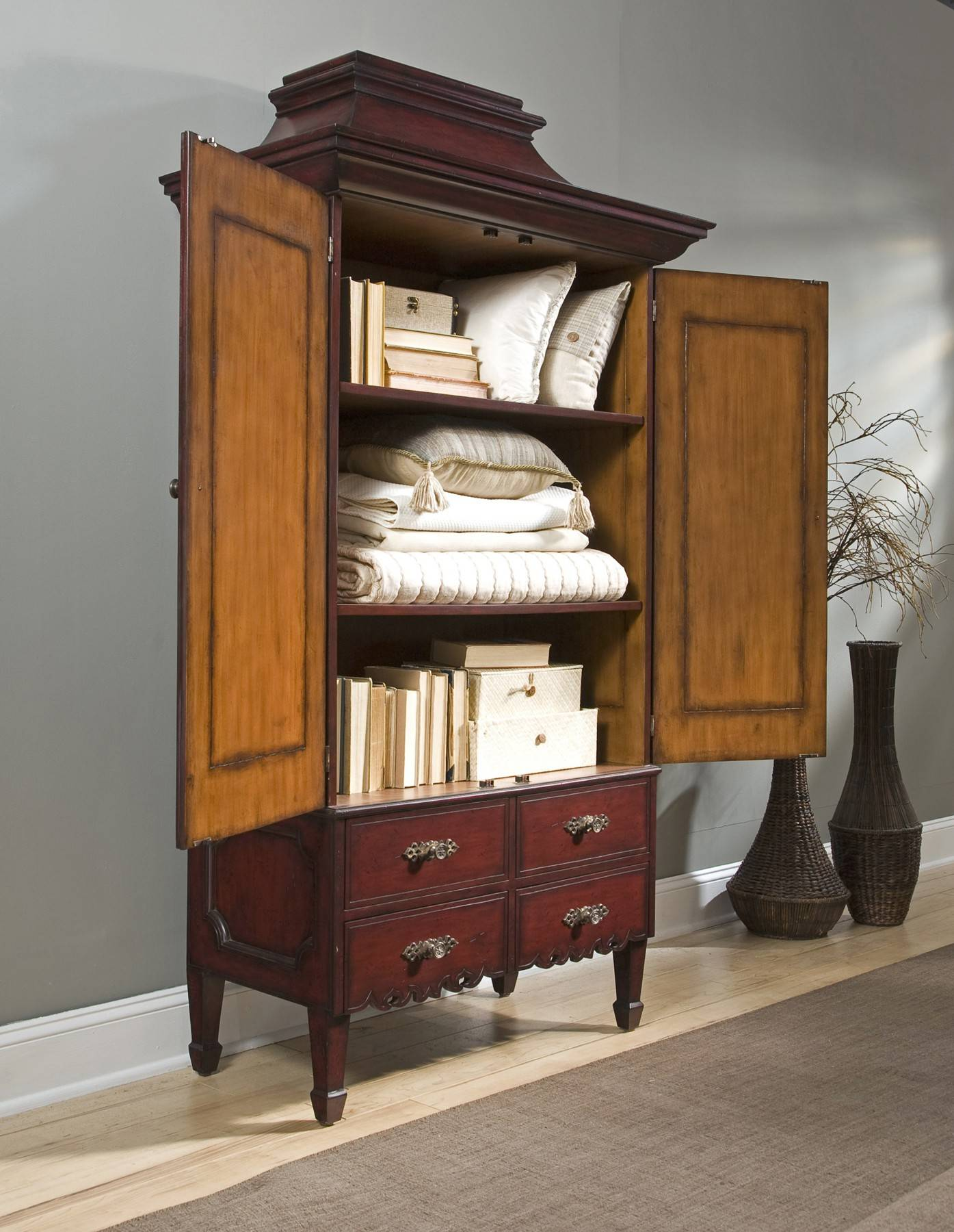 When an aging relative is downsizing into a new home, some of their furniture can be repurposed. An armoire can be used to store bed linens, pillows and memory books.