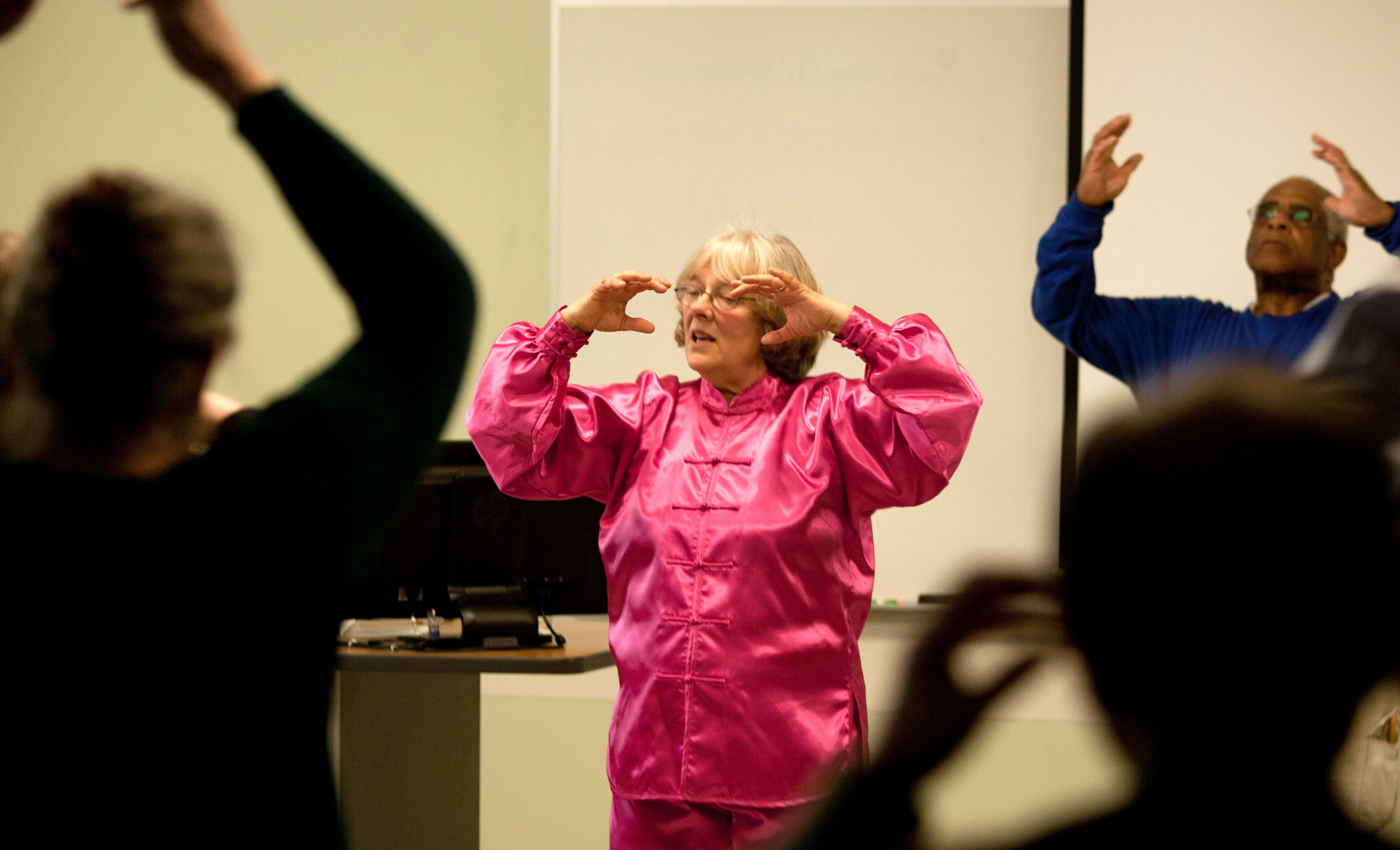 Tia Greenfield leads a Tai Chi class, an ancient Chinese martial art turned into a healing art, on Sunday during the second annual Age Well DuPage at the College of DuPage. The event showed older residents how to stay physically, mentally and fiscally healthy as they age.