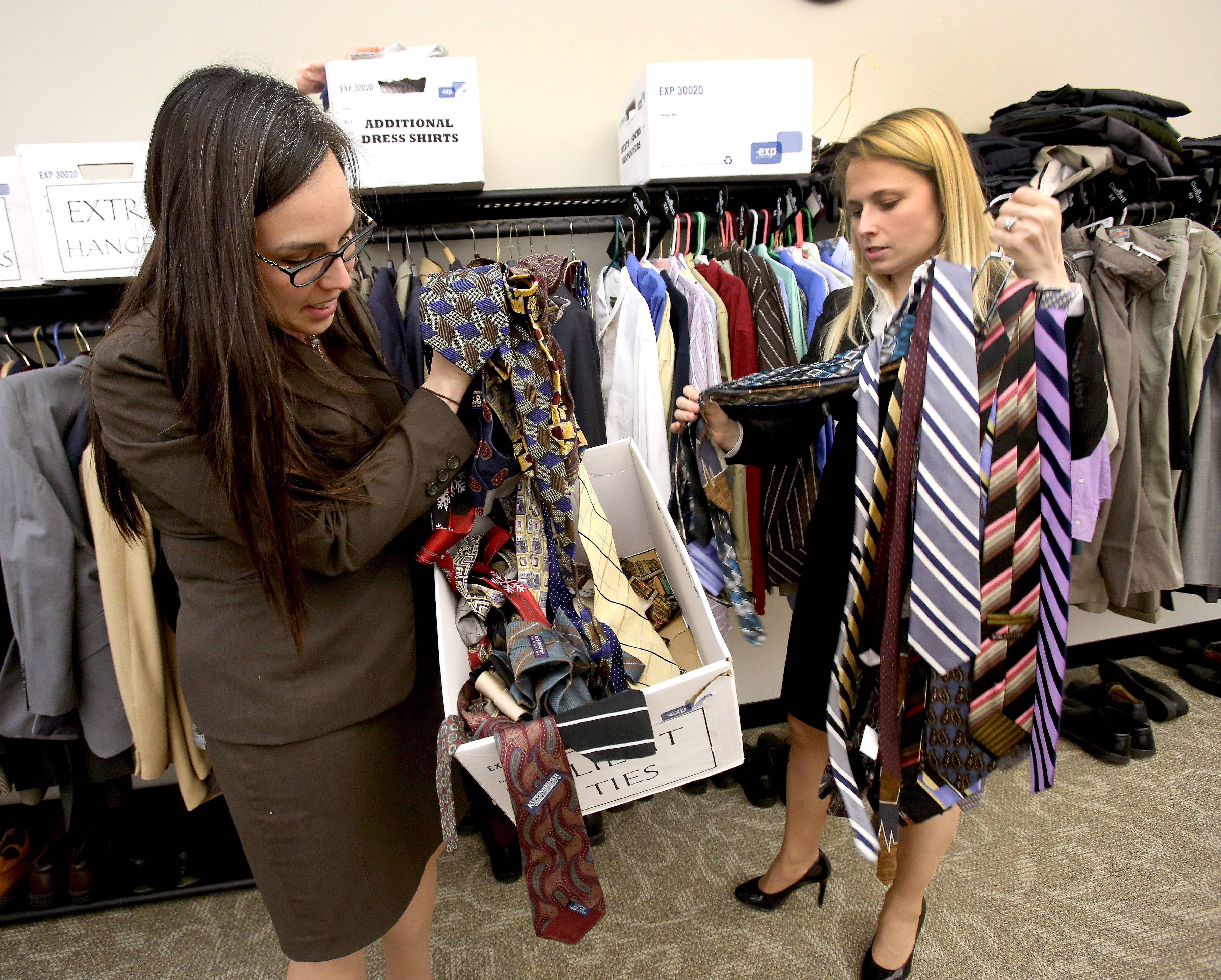 Jennifer Maples, left, and Kristen Nevdal, senior assistant DuPage County public defenders, show off the many ties available, usually for defendants going on trial.