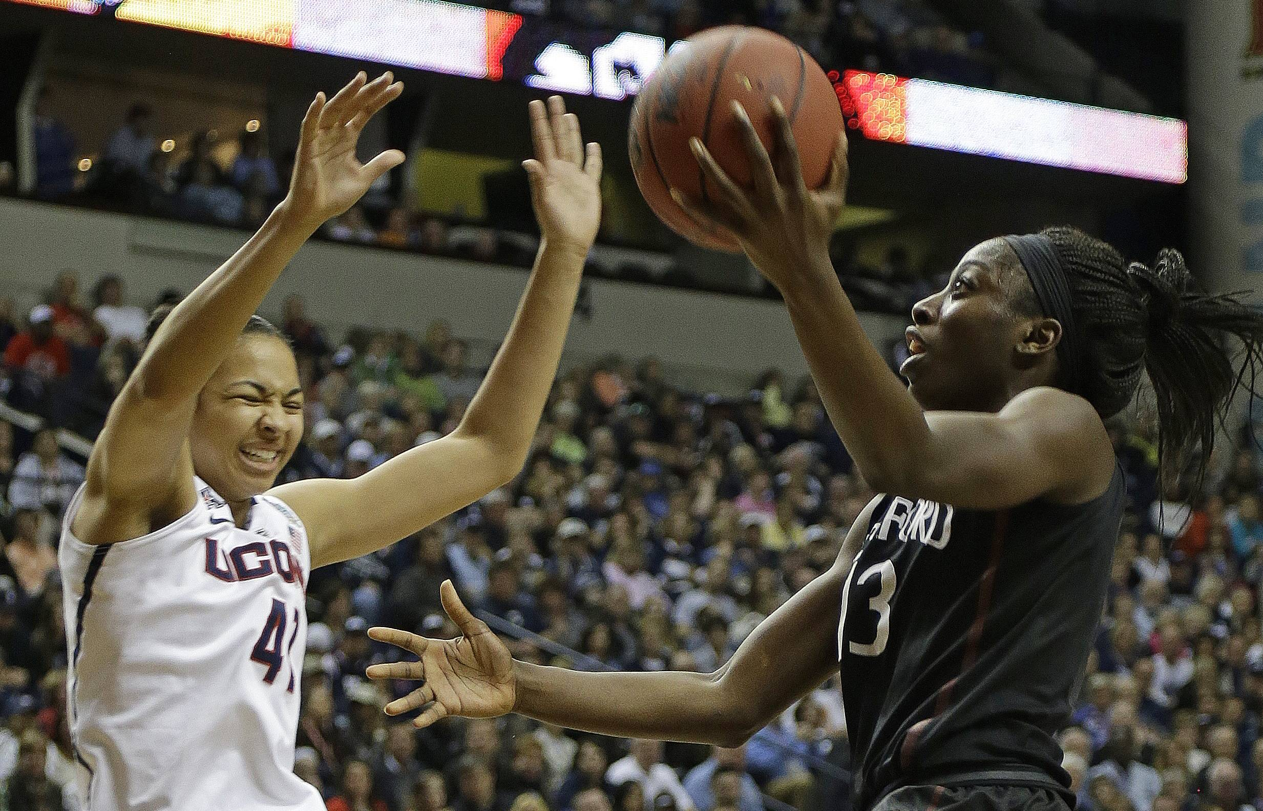 Stanford forward Chiney Ogwumike (13) shoots against Connecticut center Kiah Stokes (41) during the second half of the semifinal game in the Final Four of the NCAA women's college basketball tournament, Sunday, April 6, 2014, in Nashville, Tenn.