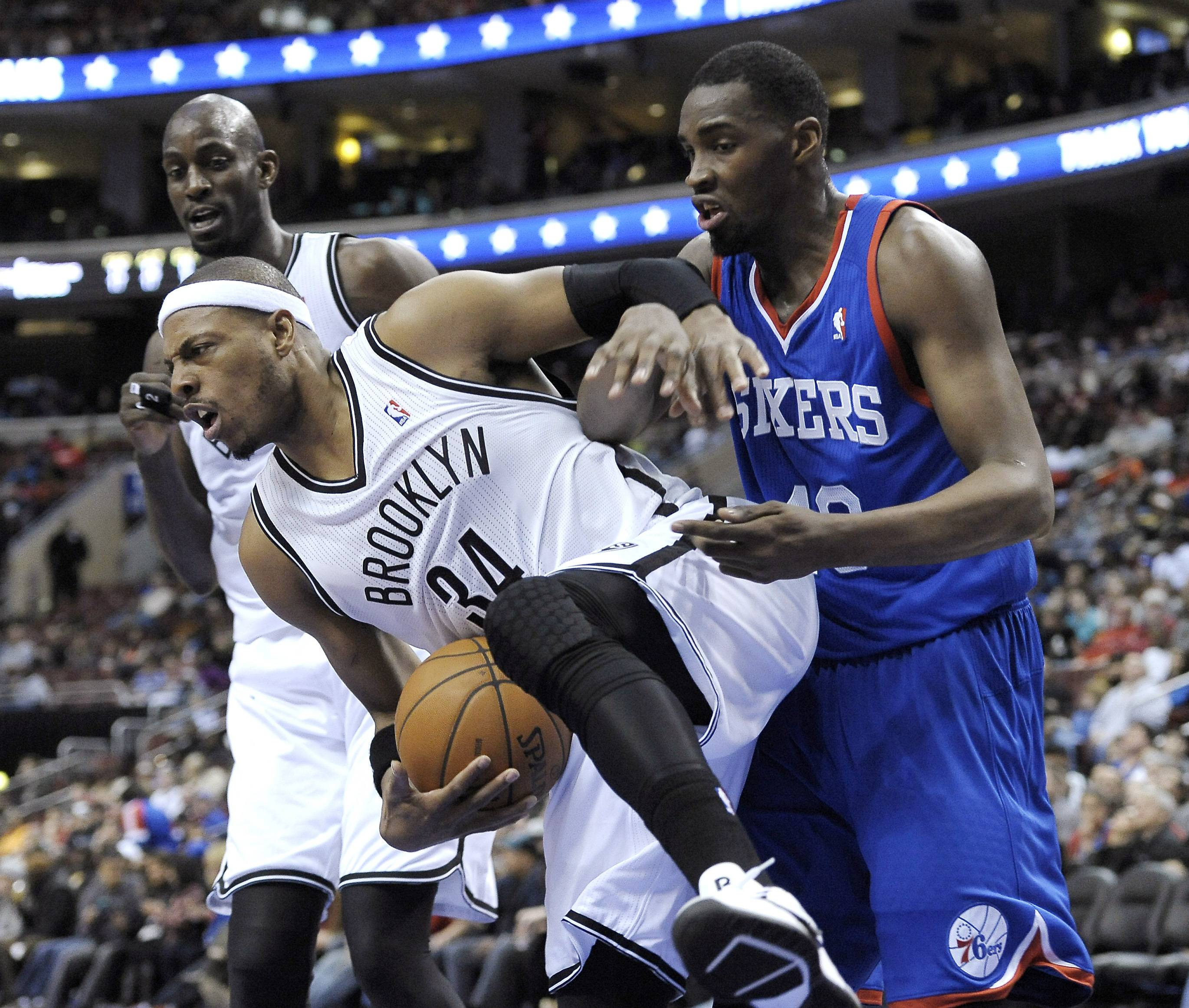 Brooklyn's Paul Pierce steals the ball from Philadelphia's Jarvis Varnado on Saturday. If the Bulls face Brooklyn in the playoffs, Pierce may be guarding Joakim Noah due to the team's three-guard starting lineup.