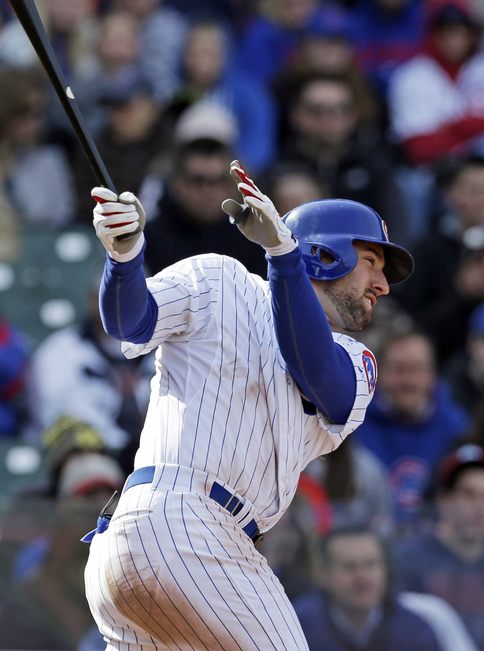 Ryan Kalish hits a 2-run double during the sixth inning of the Cubs' victory over Philadelphia on Sunday.