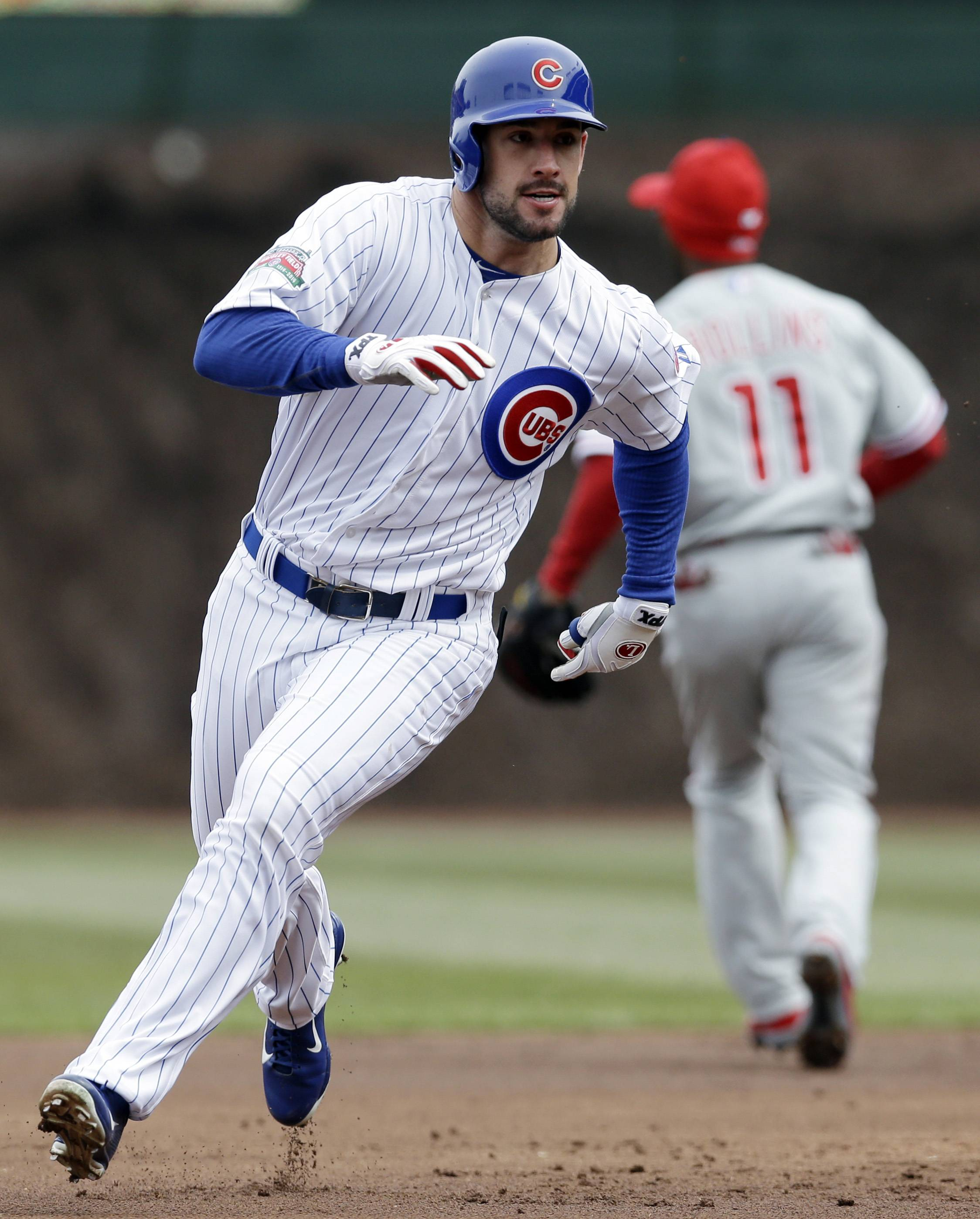Ryan Kalish runs to third after hitting a triple during the first inning of a baseball game scoring Emilio Bonifacio against the Philadelphia Phillies in Chicago, Sunday, April 6, 2014.