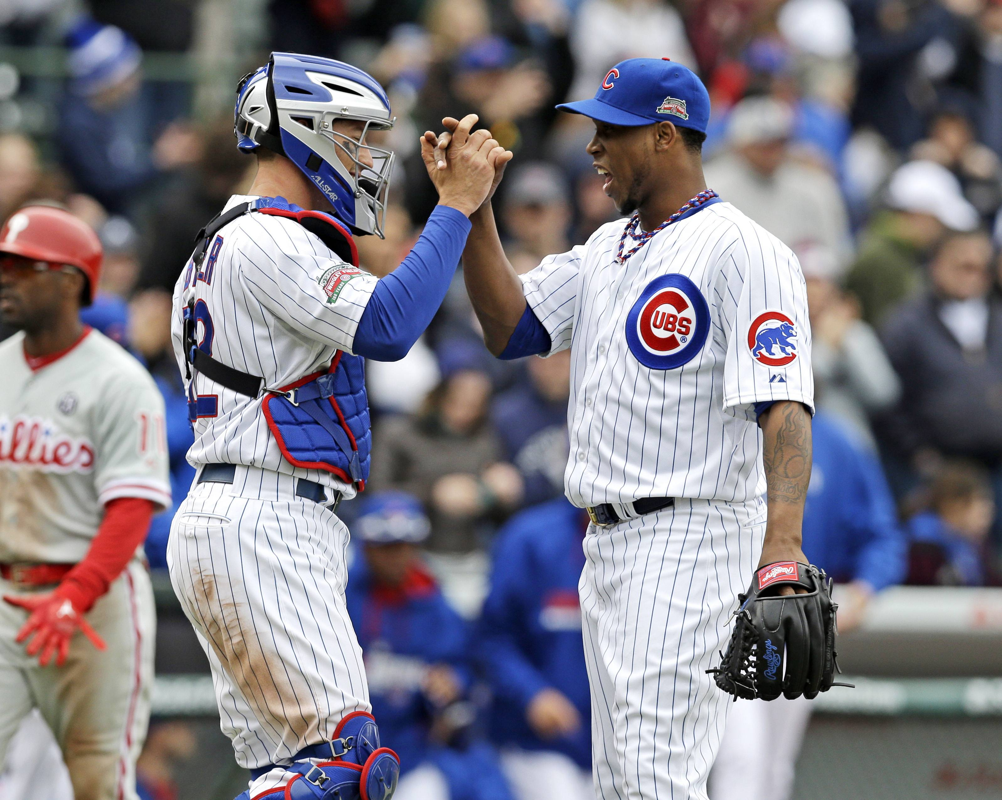 Cubs relief pitcher Pedro Strop, right, celebrates with catcher John Baker after the Cubs defeated the Philadelphia Phillies 8-3 in a baseball game in Chicago, Sunday, April 6, 2014.