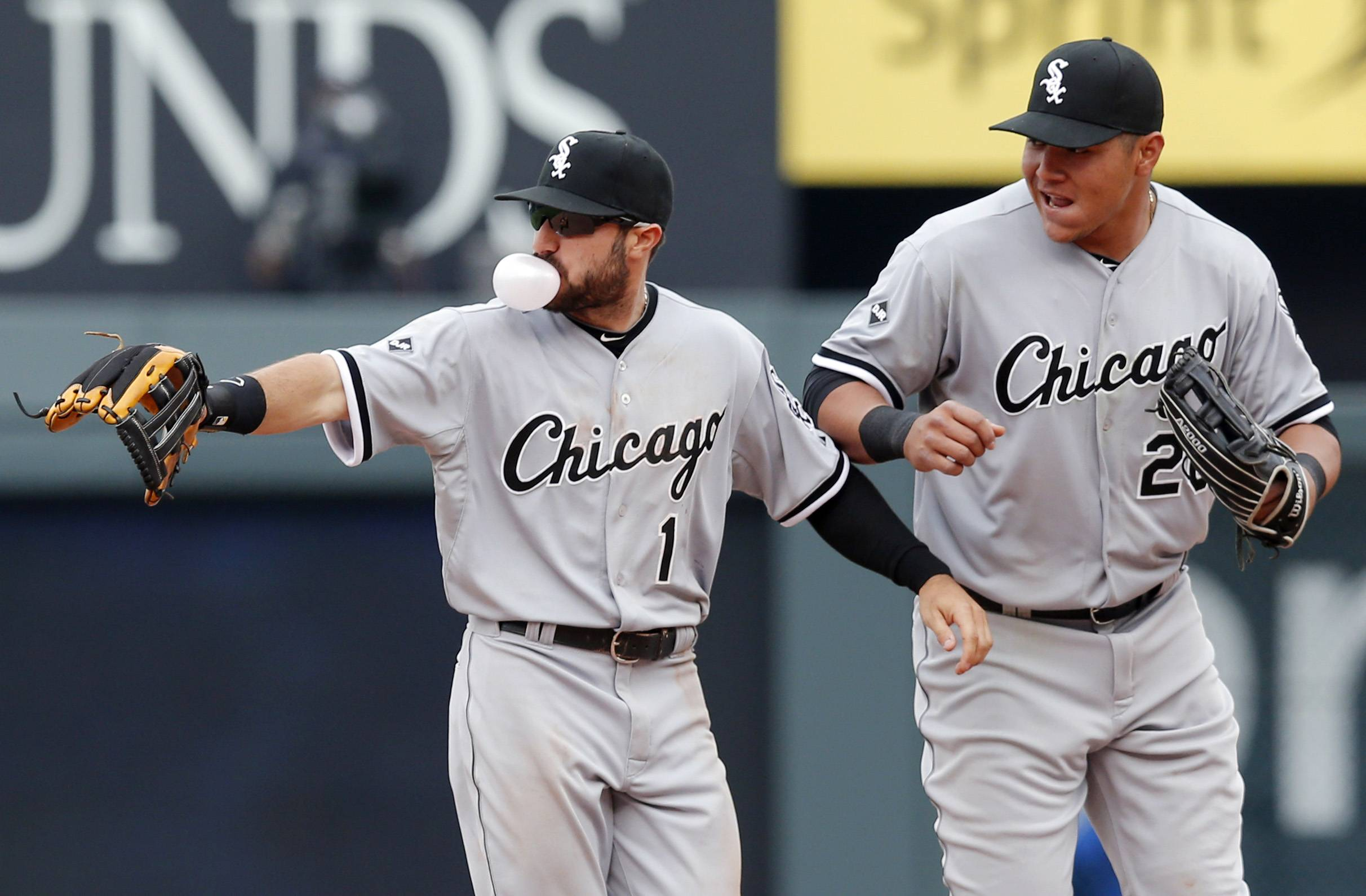 Chicago White Sox left fielder Adam Eaton (1) and right fielder Avisail Garcia (26) celebrate following a baseball game against the Kansas City Royals at Kauffman Stadium in Kansas City, Mo., Sunday, April 6, 2014. The White Sox won 5-1.