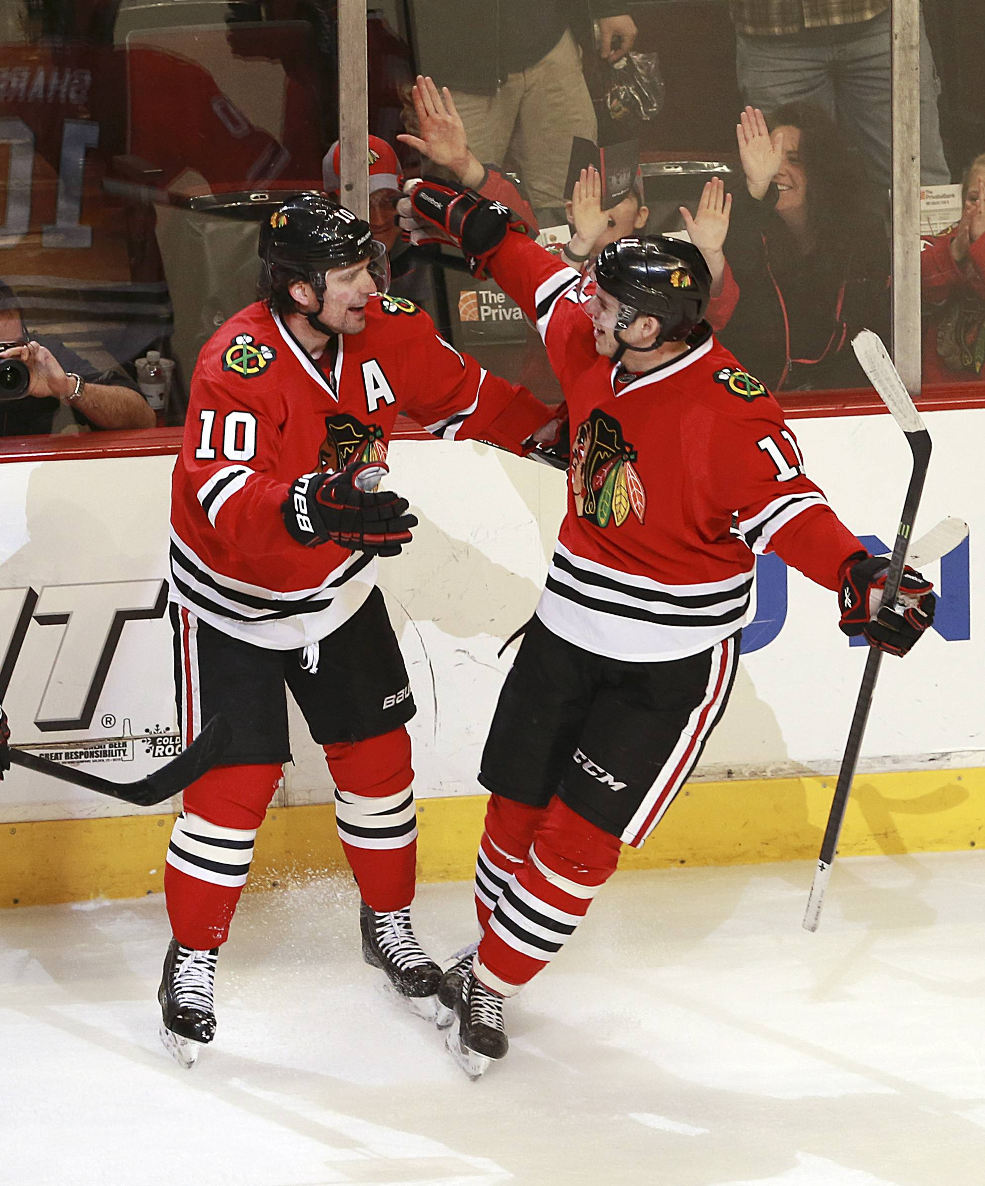 The Blackhawks' Patrick Sharp, left, and Jeremy Morin celebrate after Sharp's goal in the second period Sunday against the Blues at the United Center.
