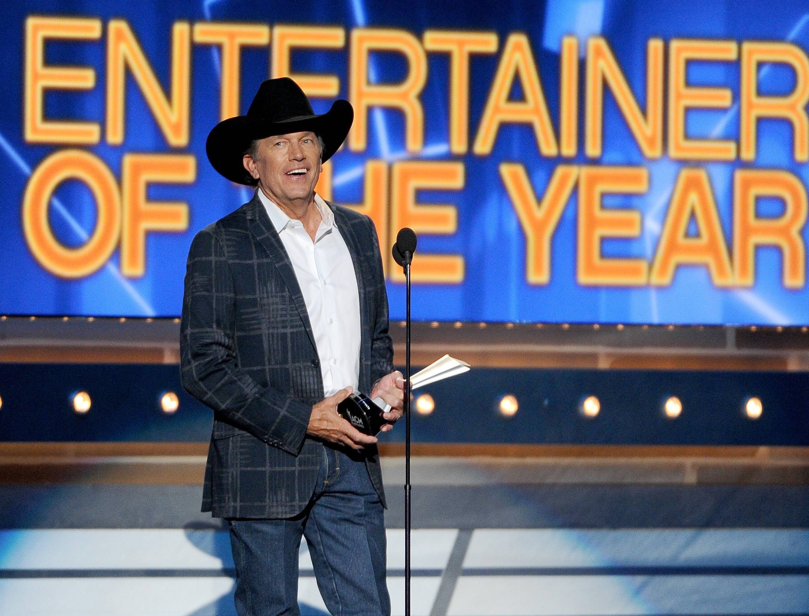 George Strait accepts the award for entertainer of the year at the 49th annual Academy of Country Music Awards at the MGM Grand Garden Arena on Sunday in Las Vegas.