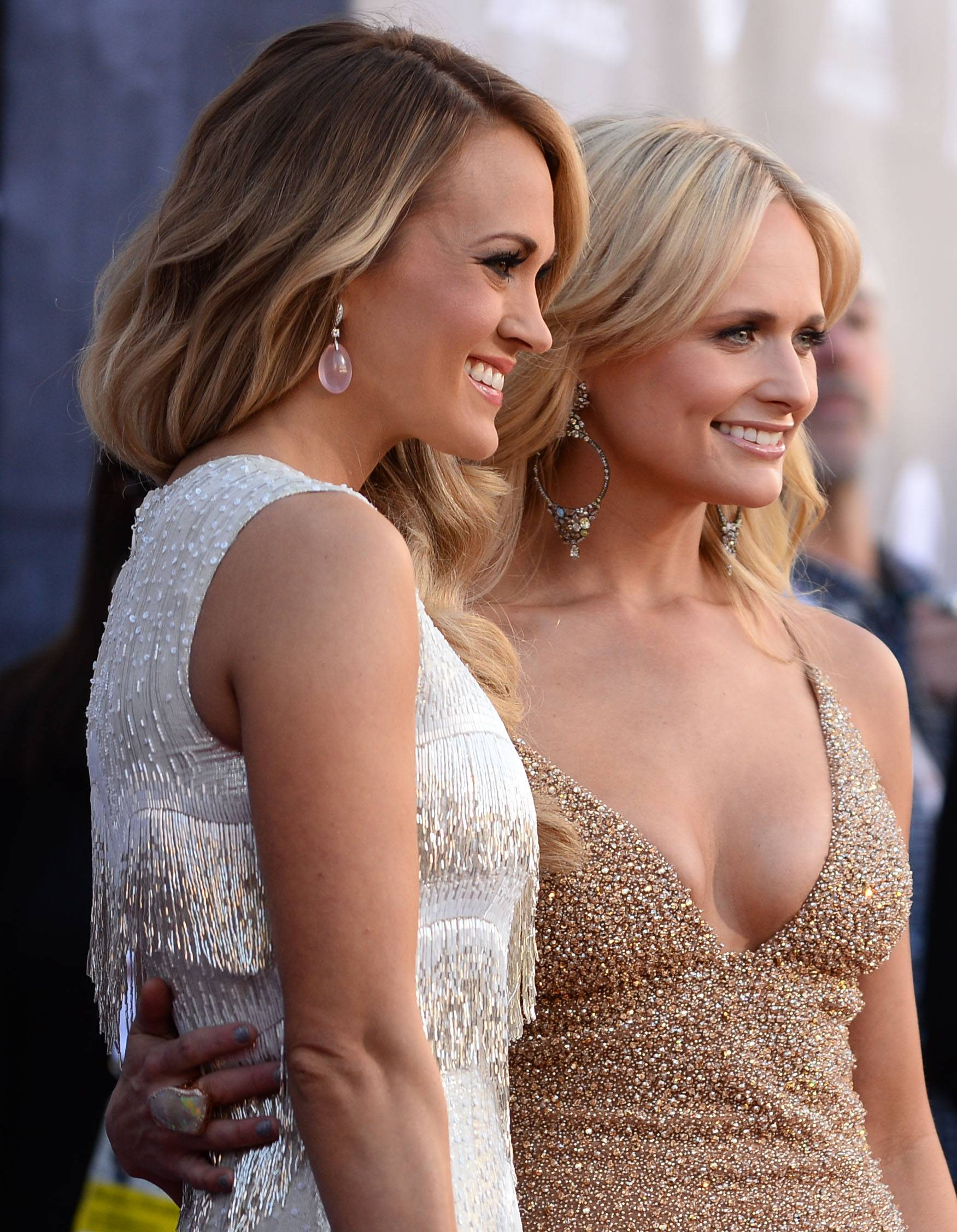 Carrie Underwood, left, and Miranda Lambert arrive at the 49th annual Academy of Country Music Awards.