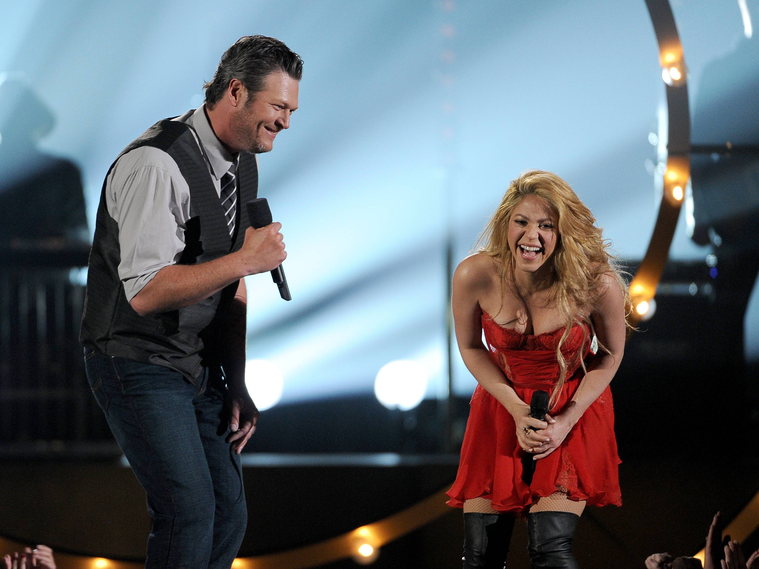 Blake Shelton and Shakira perform on stage at the 49th annual Academy of Country Music Awards.