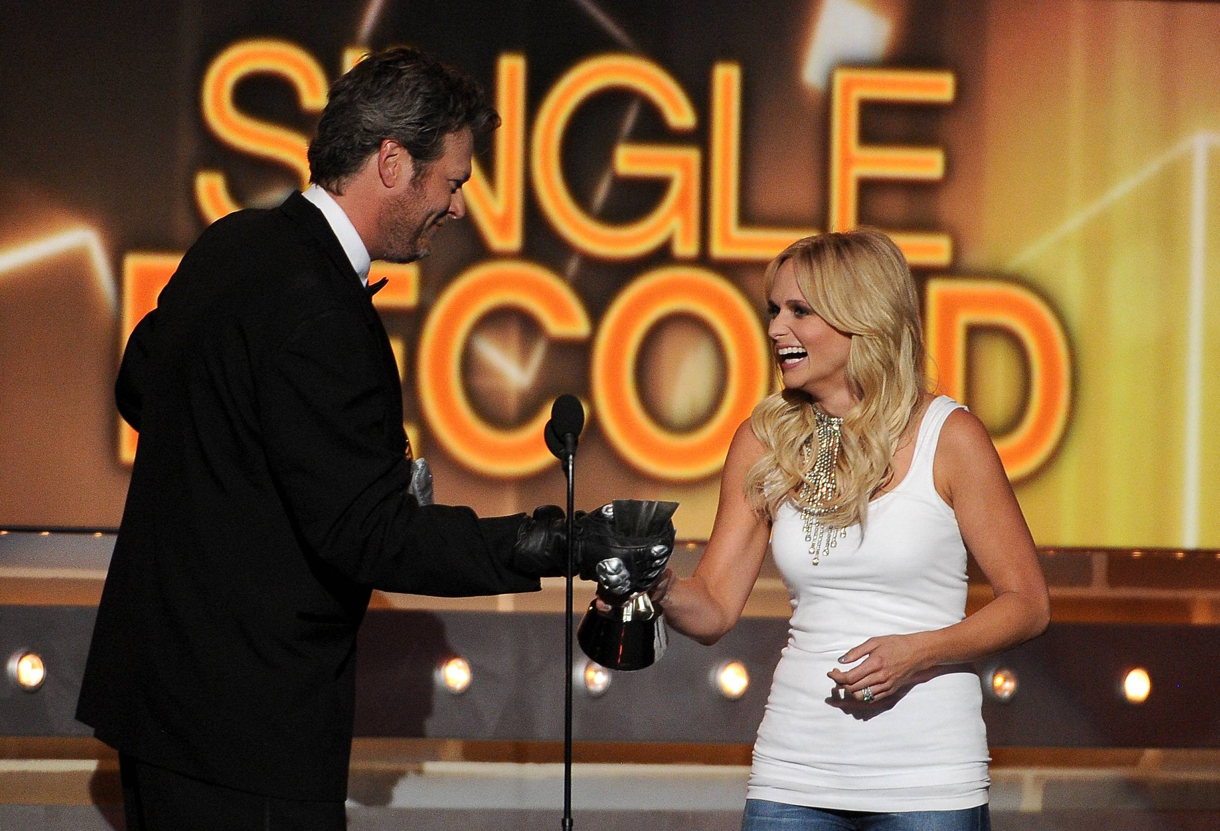 Host Blake Shelton, left, presents the single record of the year award to his wife, Miranda Lambert, at the 49th annual Academy of Country Music Awards.
