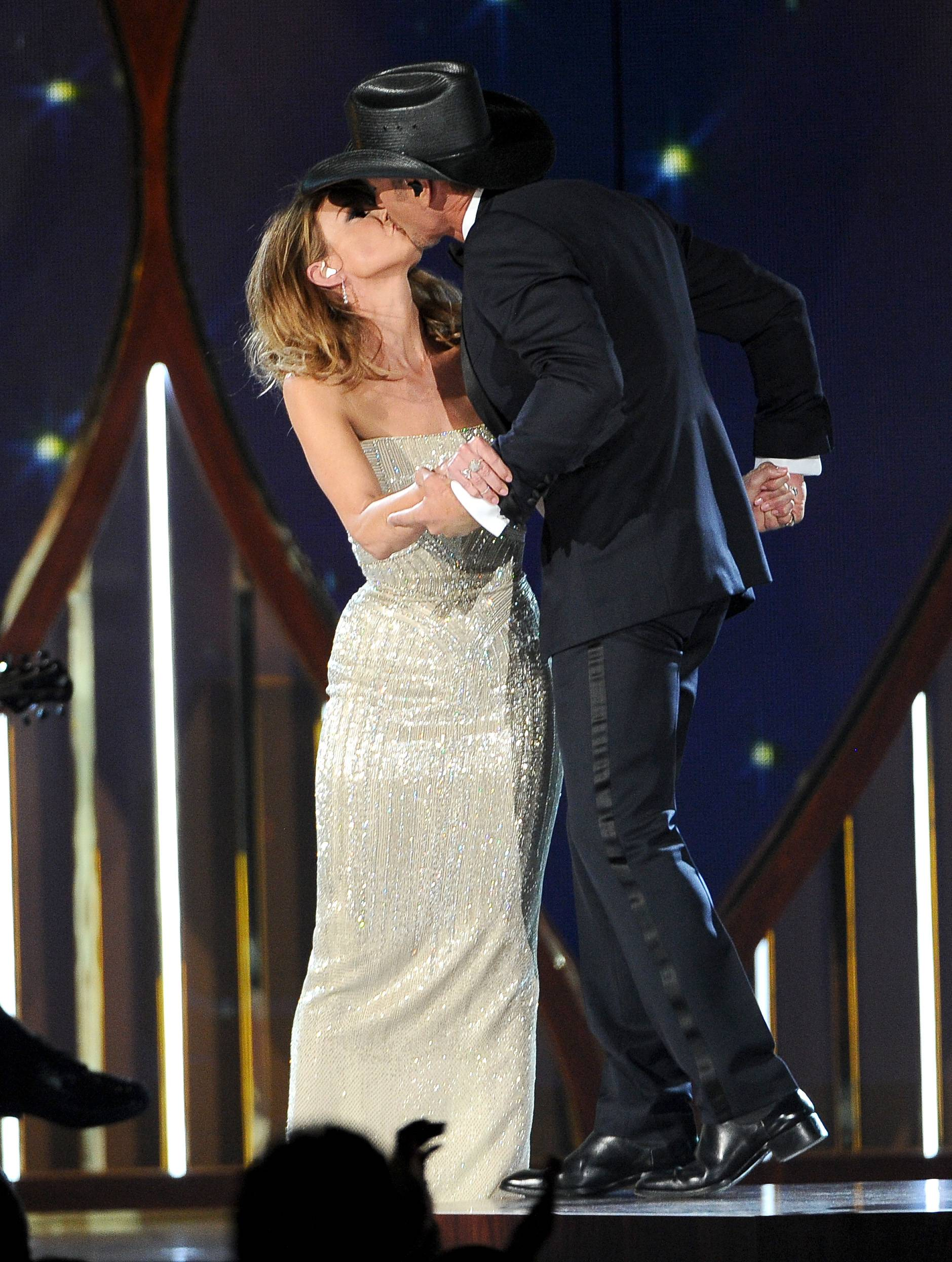 Faith Hill and Tim McGraw kiss on stage at the 49th annual Academy of Country Music Awards.