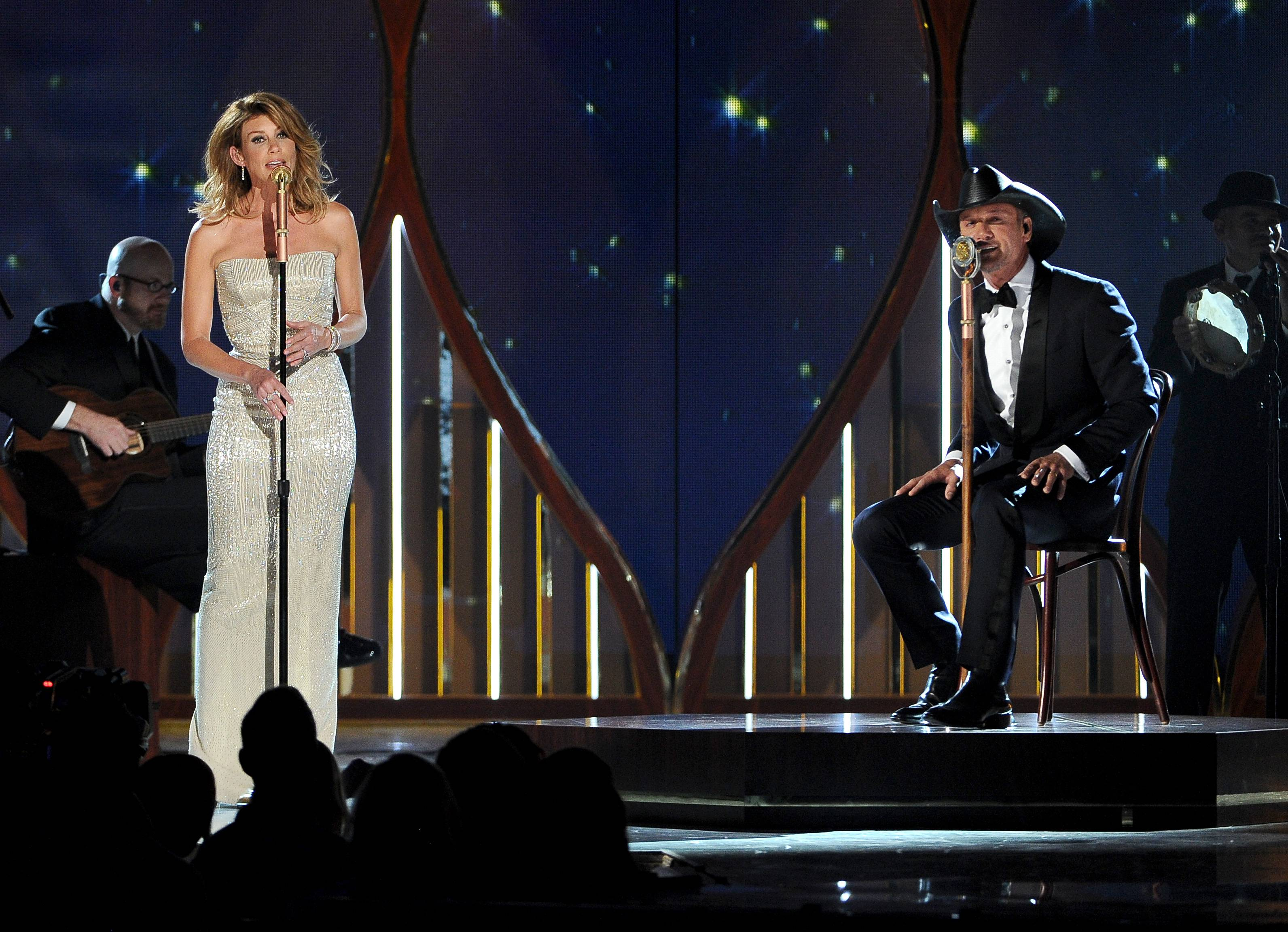 Faith Hill, left, and Tim McGraw perform on stage at the 49th annual Academy of Country Music Awards.