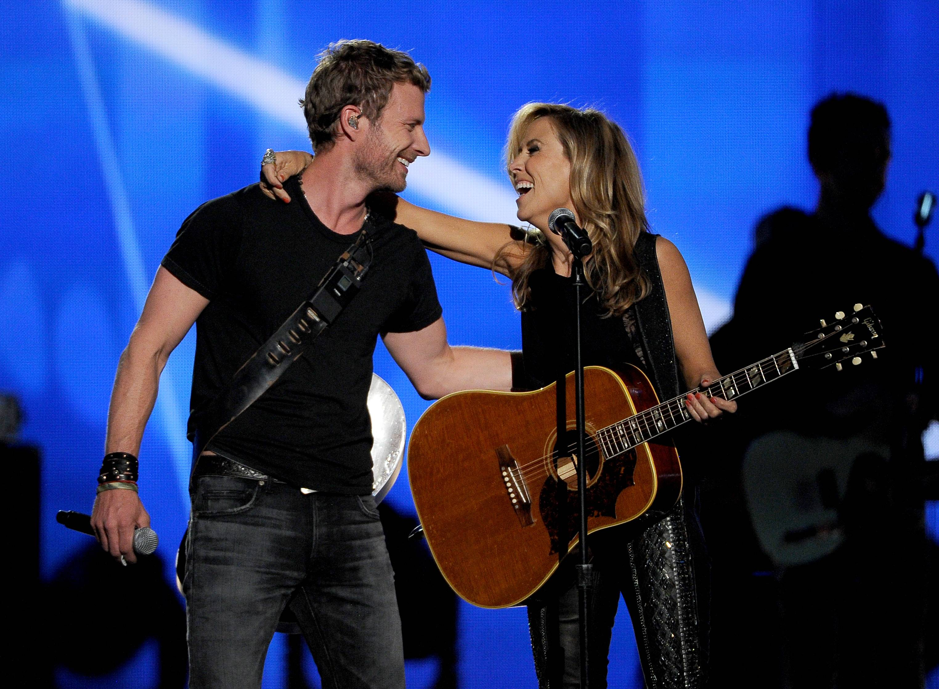 Dierks Bentley, left, and Sheryl Crow perform on stage at the 49th annual Academy of Country Music Awards at the MGM Grand Garden Arena on Sunday in Las Vegas.