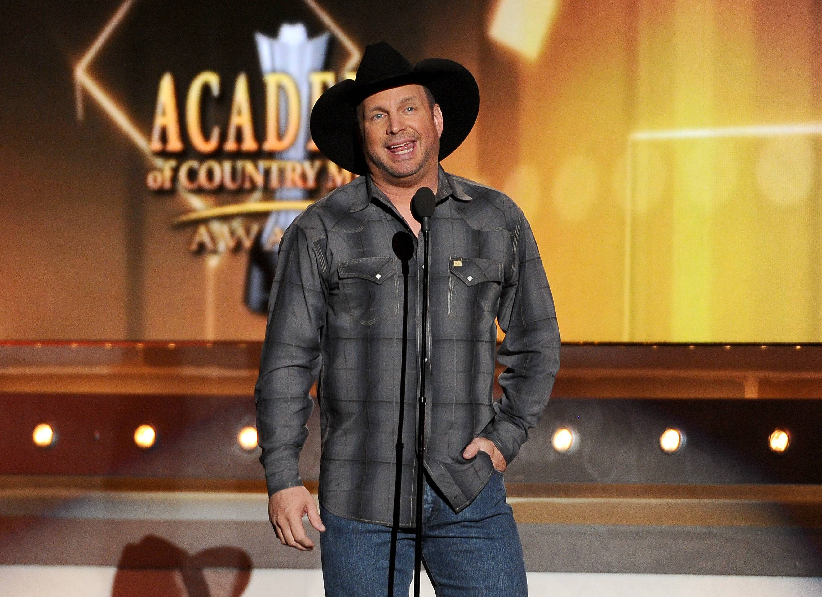 Garth Brooks speaks on stage at the 49th annual Academy of Country Music Awards.