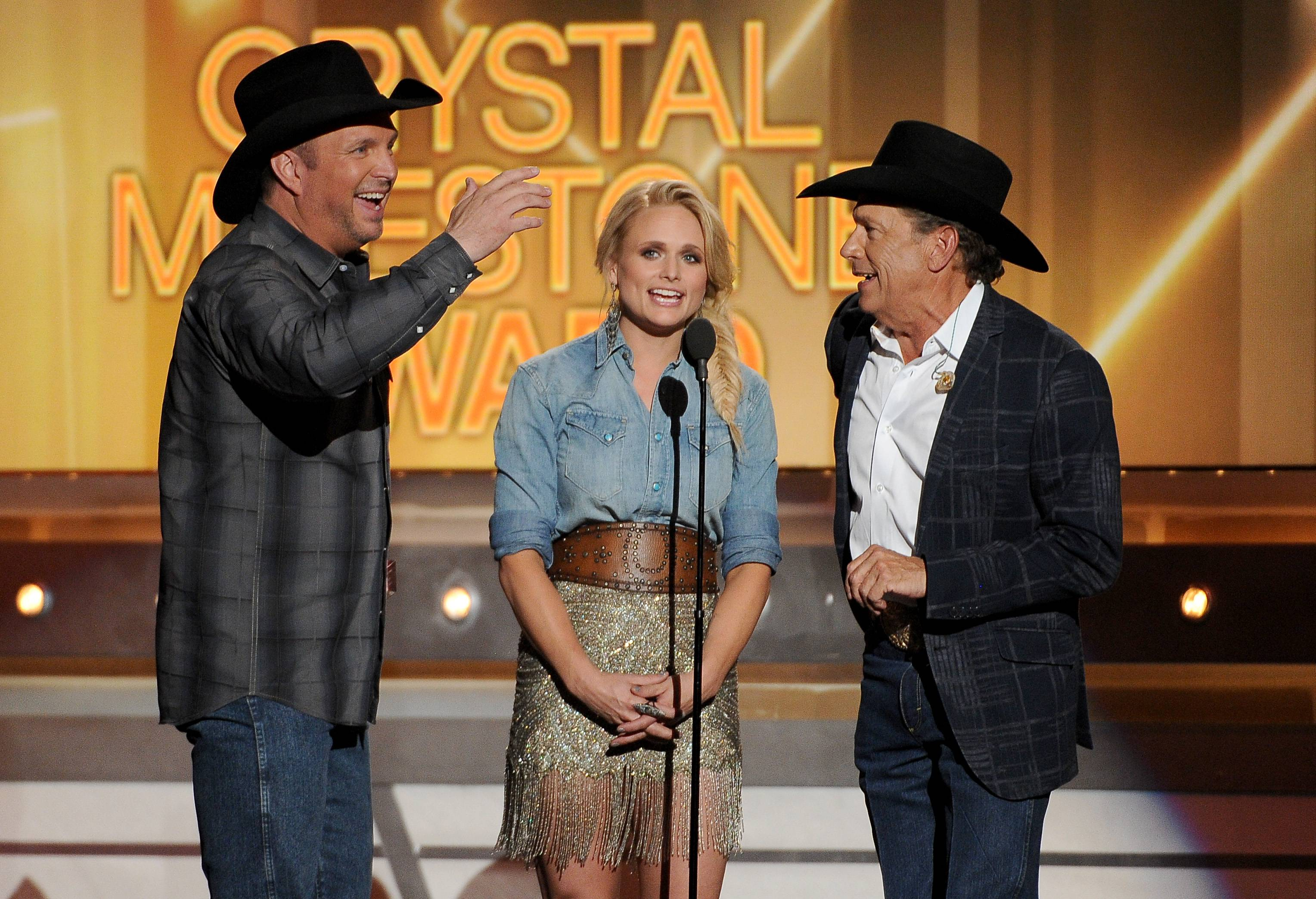 Garth Brooks, Miranda Lambert and George Strait speak on stage at the 49th annual Academy of Country Music Awards at the MGM Grand Garden Arena on Sunday in Las Vegas.