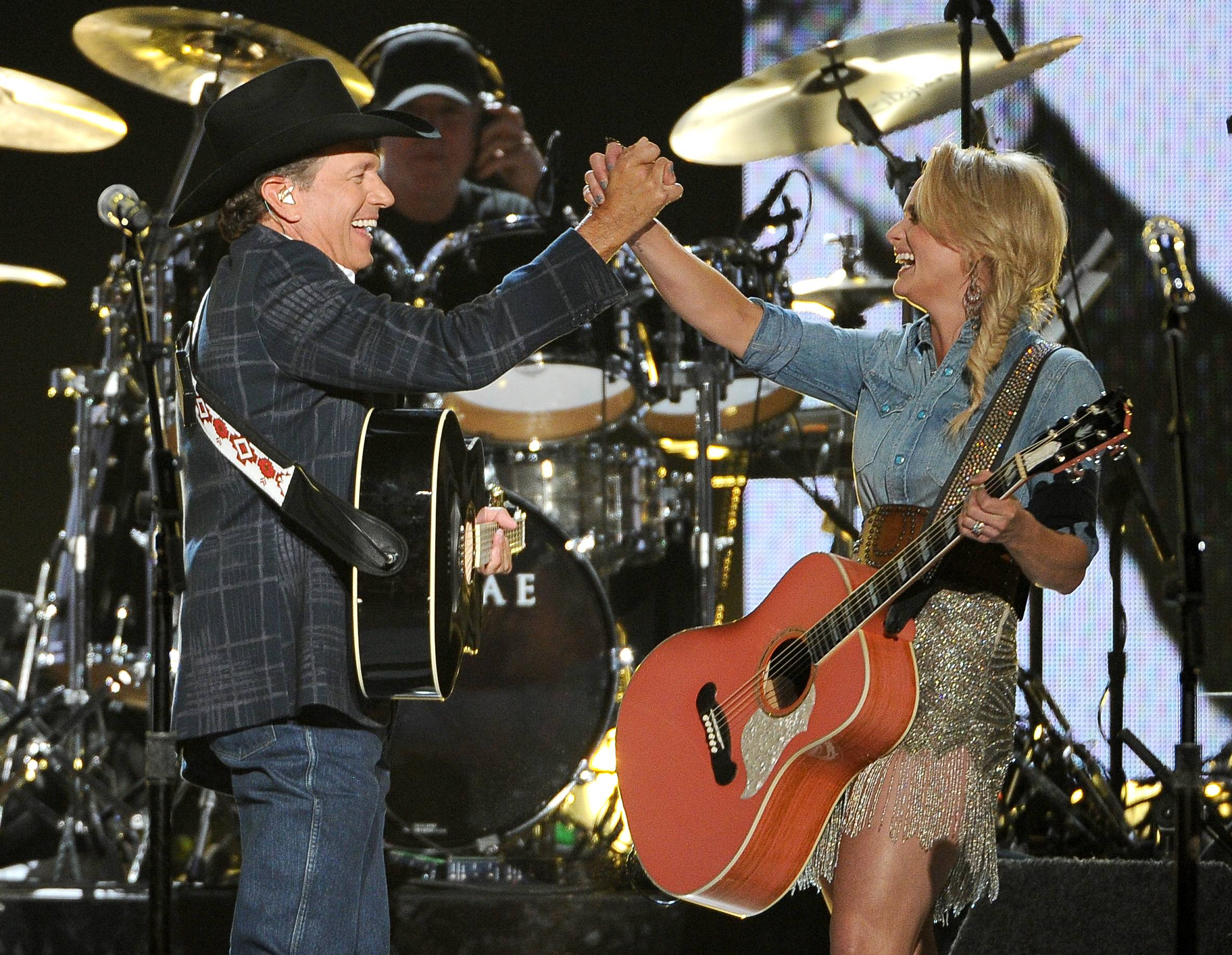 George Strait, left, and Miranda Lambert perform on stage at the 49th annual Academy of Country Music Awards.