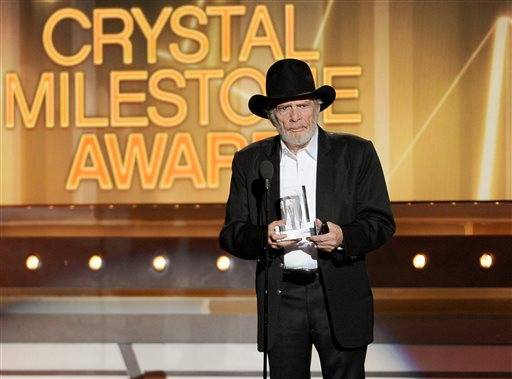 Merle Haggard accepts the crystal milestone award at the 49th annual Academy of Country Music Awards.