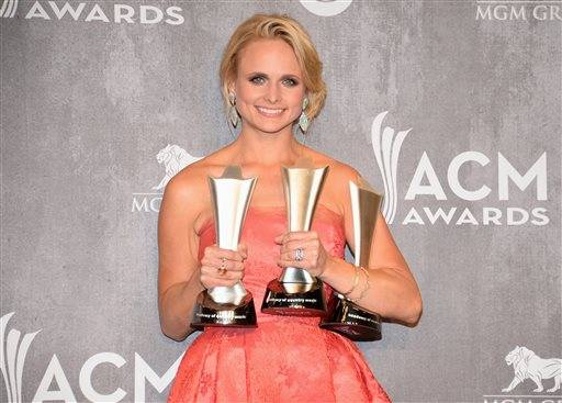 Miranda Lambert holds her three ACM awards while posing for photographers in the press room Sunday night.