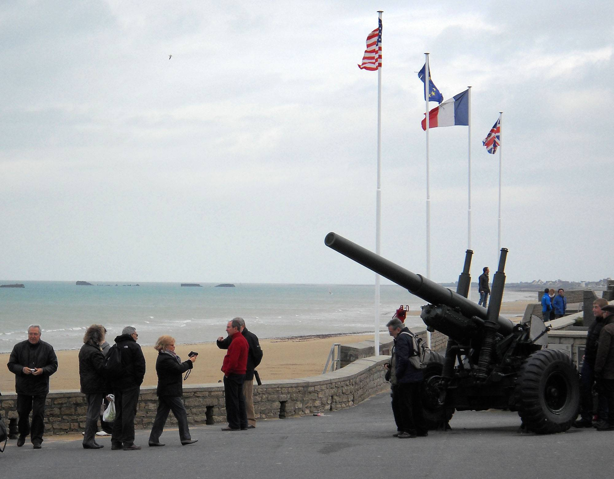 Tourists take photos outside of the seaside D-Day Museum (Musee du Debarquement) in Arromanches, France. Arromanches is one of several beaches on the coast of Normandy likely to see an influx of tourists for the 70th anniversary of D-Day on June 6, 2014.