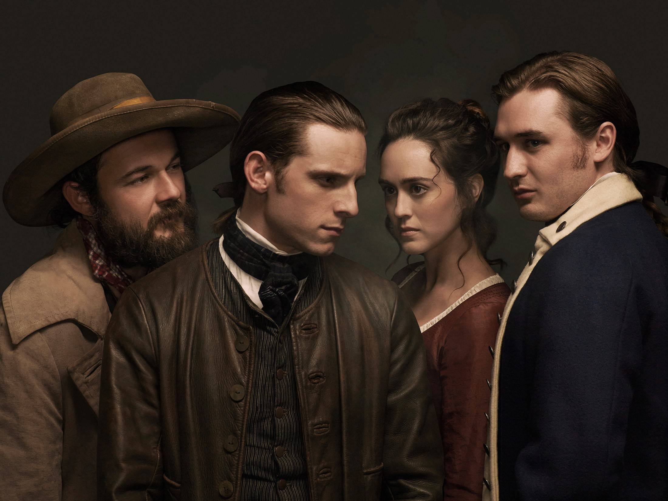 "Caleb (Daniel Henshall, left), Abraham (Jamie Bell), Anna (Heather Lind) and Ben (Seth Numrich) find themselves part of a spy ring during the Revolutionary War in AMC's new historical drama ""Turn."""