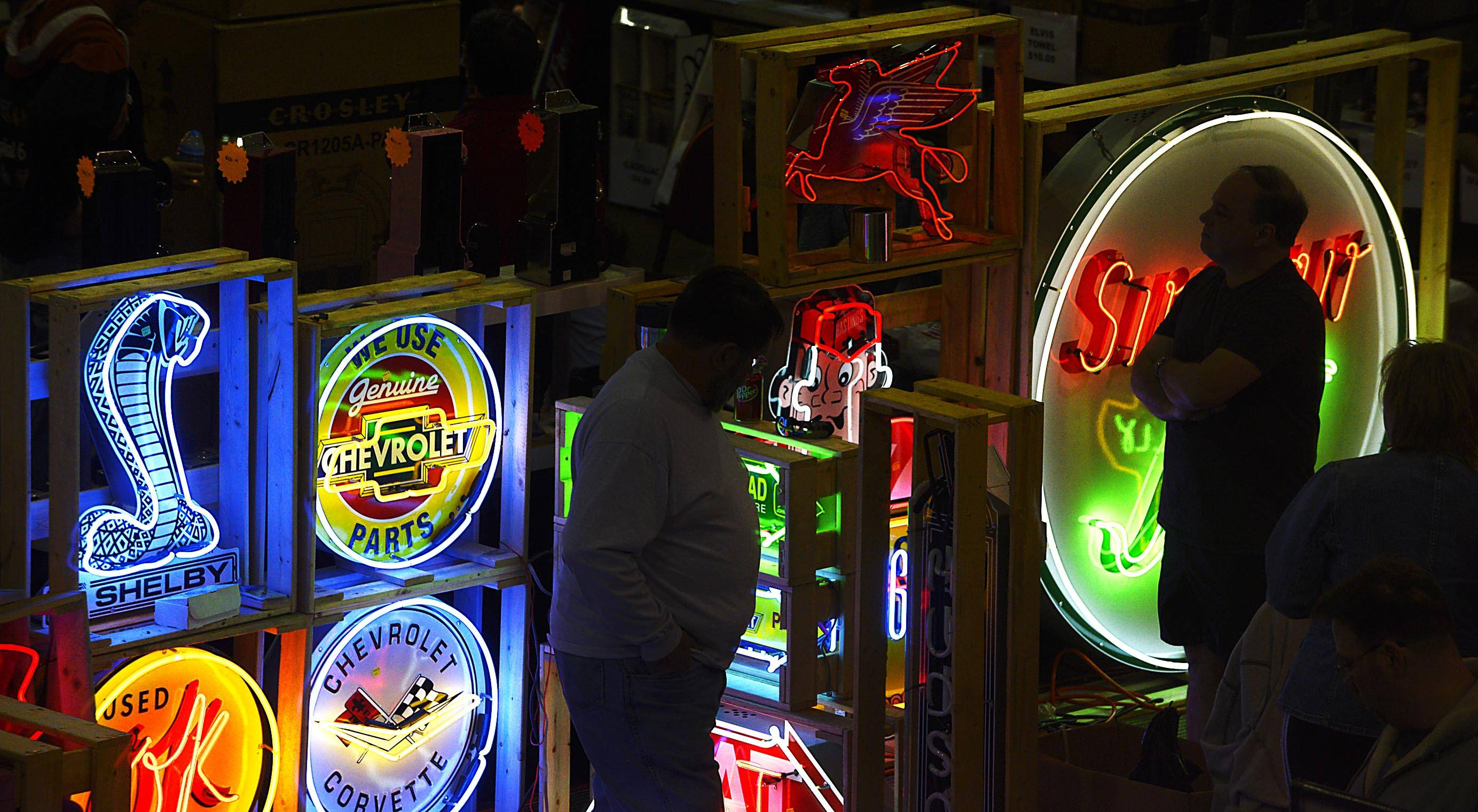 Neon signs attract visitors Sunday at the Chicagoland Antique Advertising, Slot-Machine & Jukebox Show at the Pheasant Run Resort in St. Charles.