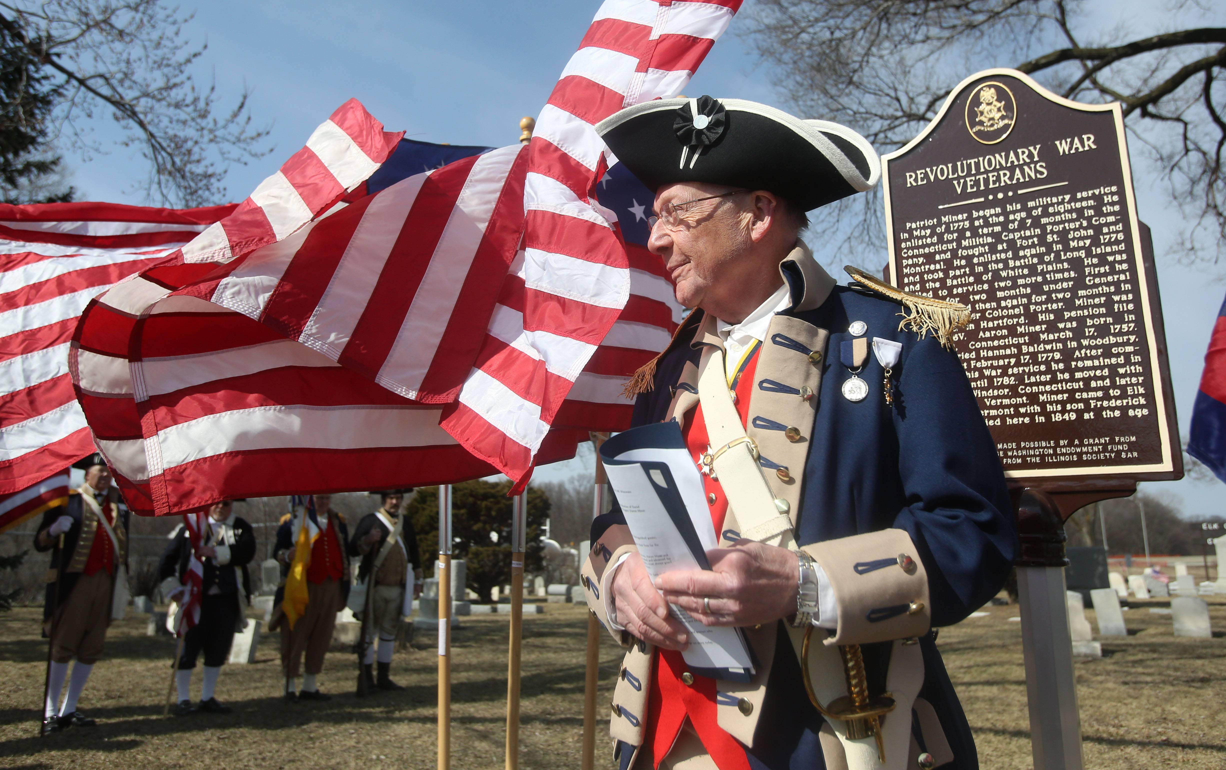 Franz Herder, chairman of the Illinois Society Sons of the American Revolution's Cemetery Marker Program, speaks during a ceremony Sunday dedicating historical markers for two Revolutionary War figures buried at Elk Grove Cemetery.