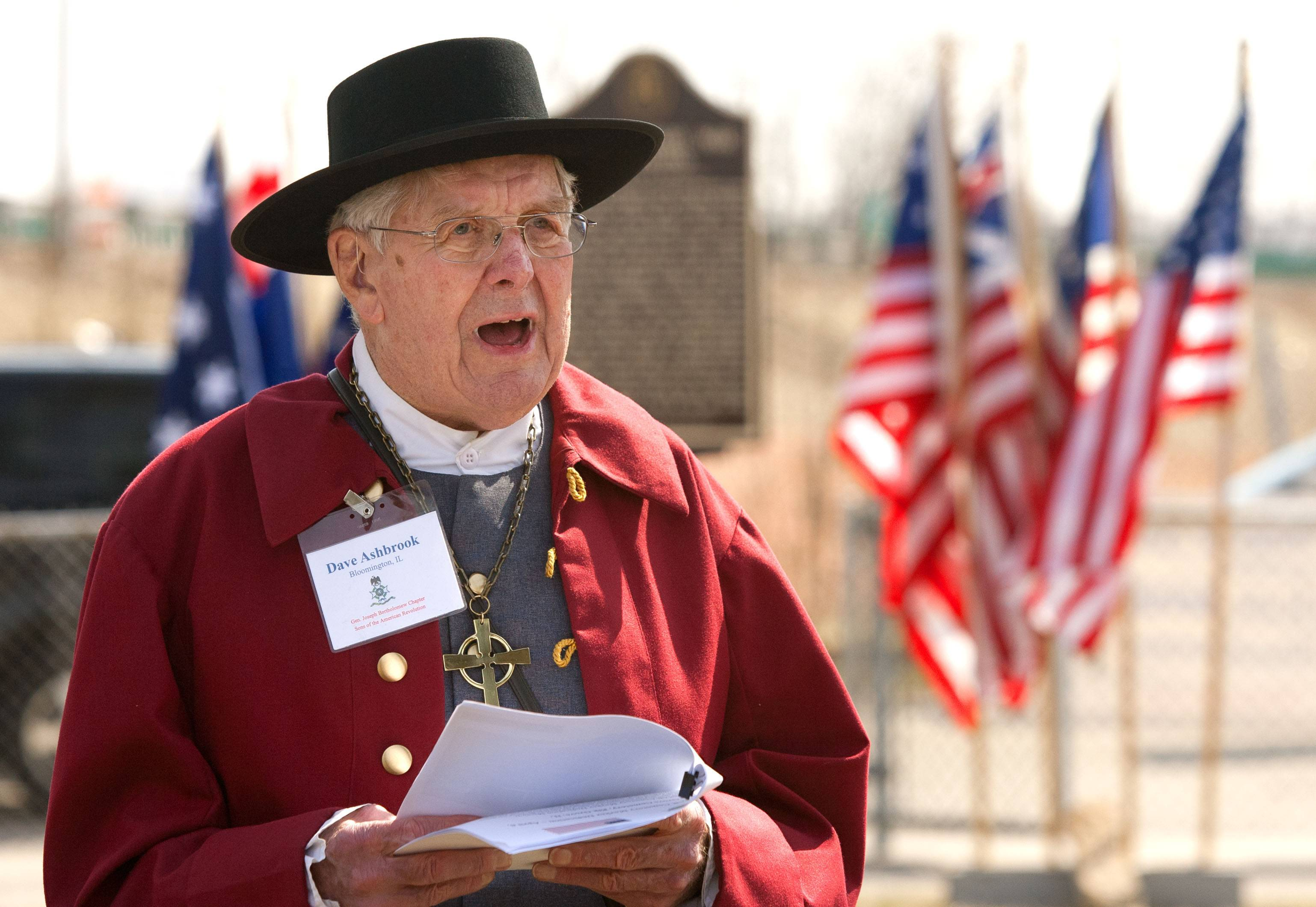 Dave Ashbrook, chaplain of the Illinois Society Sons of the American Revolution, delivers the benediction Sunday during a ceremony dedicating historical markers for two Revolutionary War figures buried at Elk Grove Cemetery.