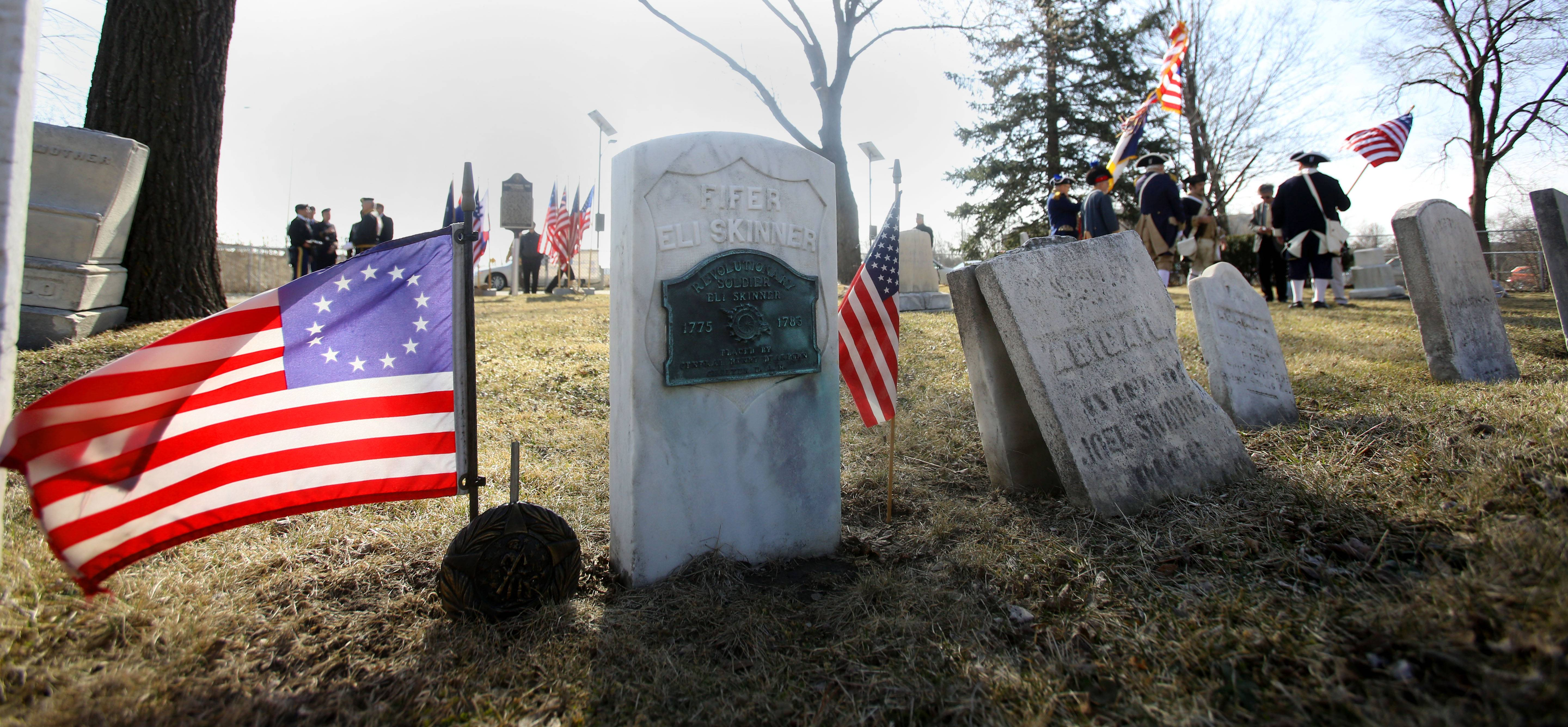 The Illinois Society Sons of the American Revolution installed historical markers Sunday at Elk Grove Cemetery, recognizing two Revolutionary War figures buried there. Above is the gravesite of Eli Skinner.