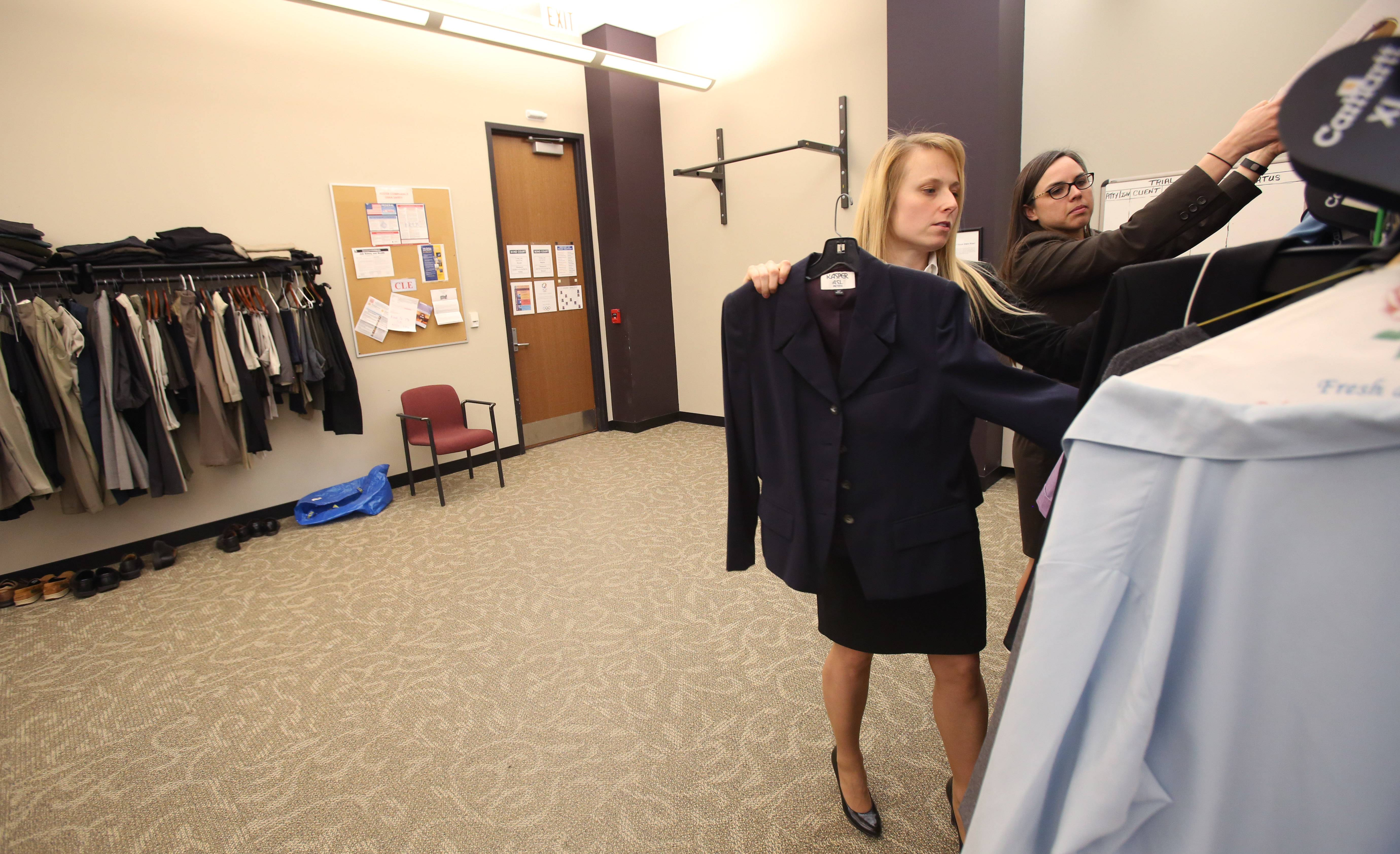 Kristen Nevdal, left and Jennifer Maples, senior assistant public defenders, sort through clothes available for a defendants at trial.