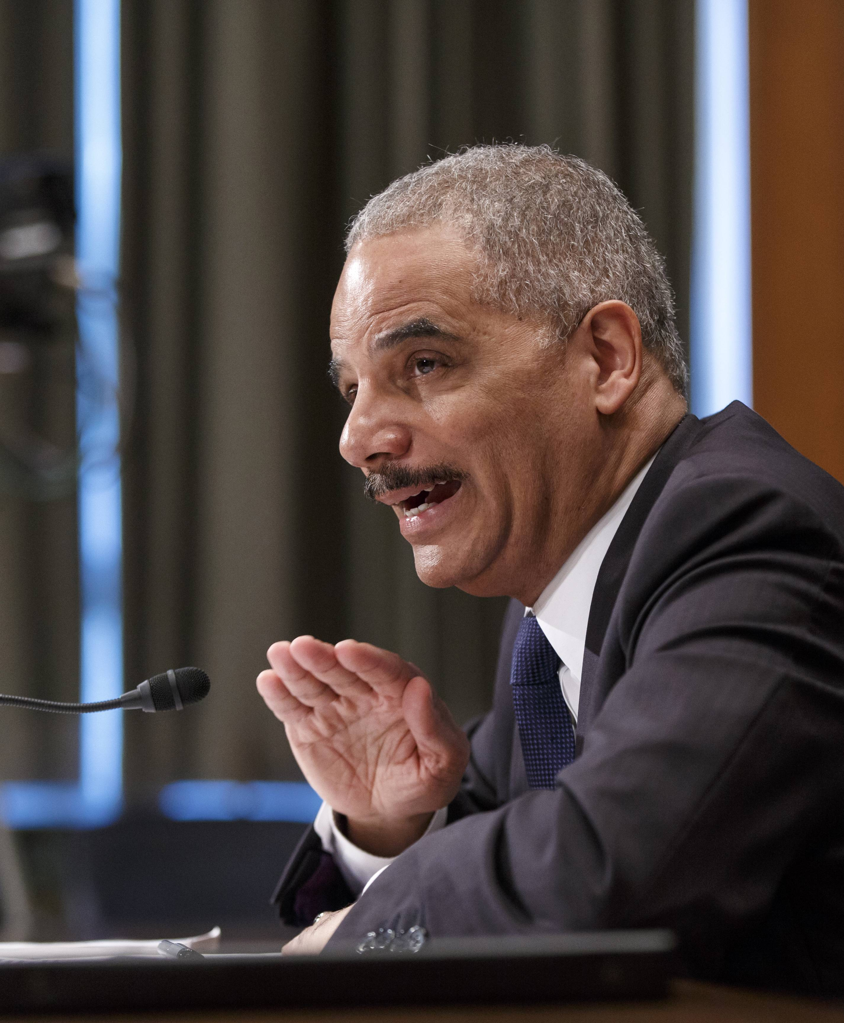Attorney General Eric Holder testifies on Capitol Hill in Washington, Thursday, April 3, 2014, before a Senate Appropriations subcommittee on proposed budget estimates for fiscal year 2015 for the Justice Department. Holder said the government needs to deal differently with the heroin epidemic than it did with the crack cocaine crisis decades ago.