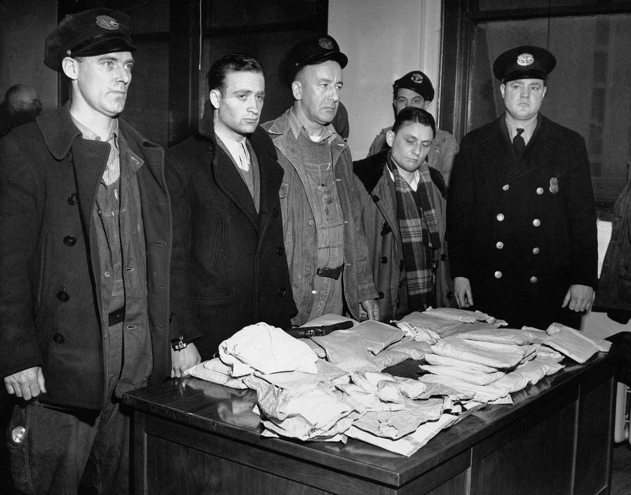 In this March 17, 1947 file photo, about 459 ounces of pure heroin valued at over one million dollars in the black market lies on table in Customs Enforcement Bureau in New York following seizure aboard the French freighter Saint Tropez after its arrival in New York City from Marseilles.