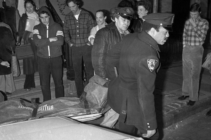 In this Feb. 2, 1979 file photo, New York City police carry the body of punk rock singer Sid Vicious from an apartment in the Greenwich Village area of New York. Authorities said that Sid Vicious, whose real name was John Simon Ritchie, apparently died of an overdose of heroin he took at a party celebrating his release from prison the day before.