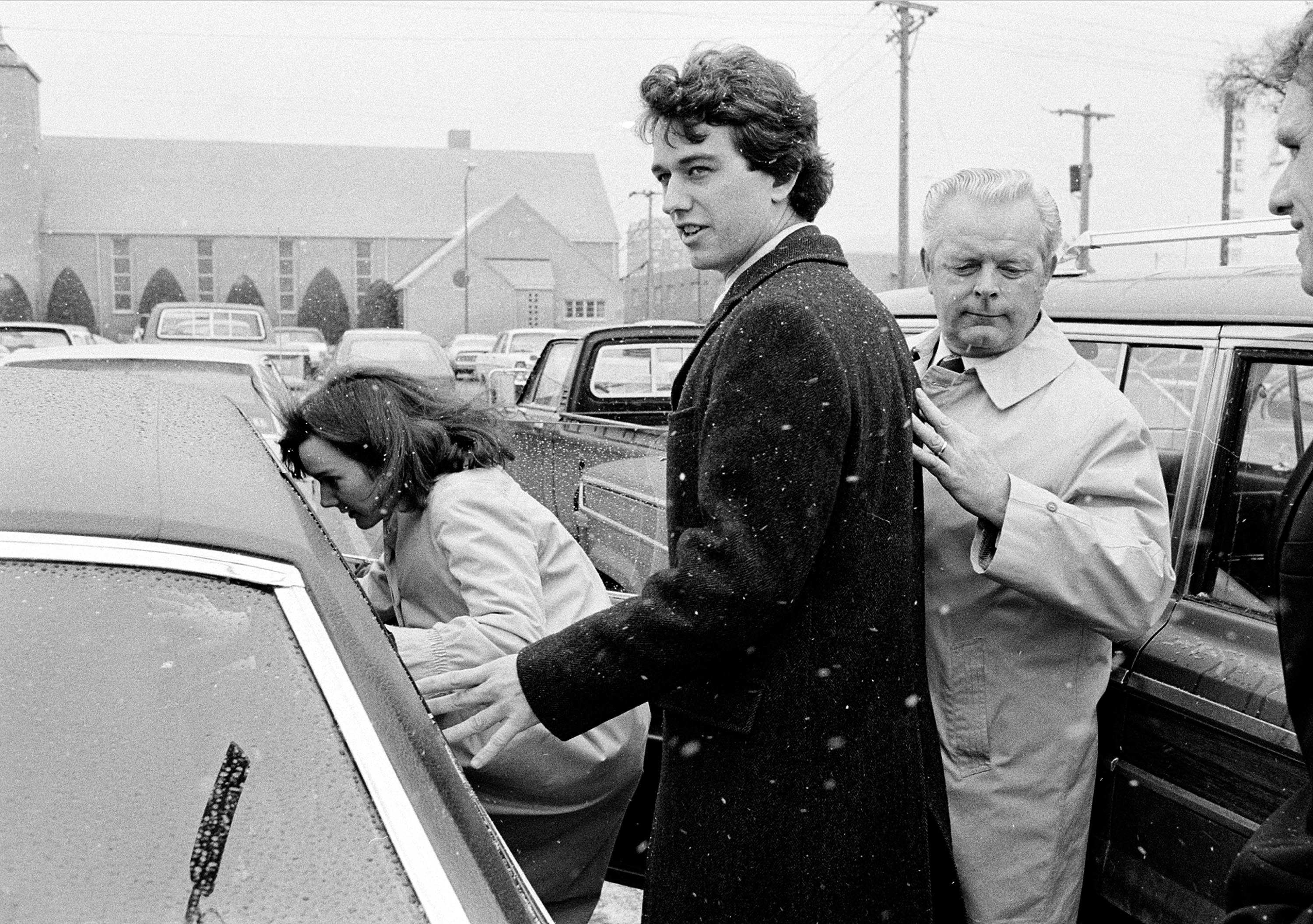 FILE - In this March 17, 1984 file photo, Robert Kennedy Jr. and his wife, Emily, get into a car as they are escorted by private investigator Don Wiley outside the courthouse in Rapid City, S.D. Kennedy received a suspended sentence and two years probation on his guilty plea to a charge of heroin possession.