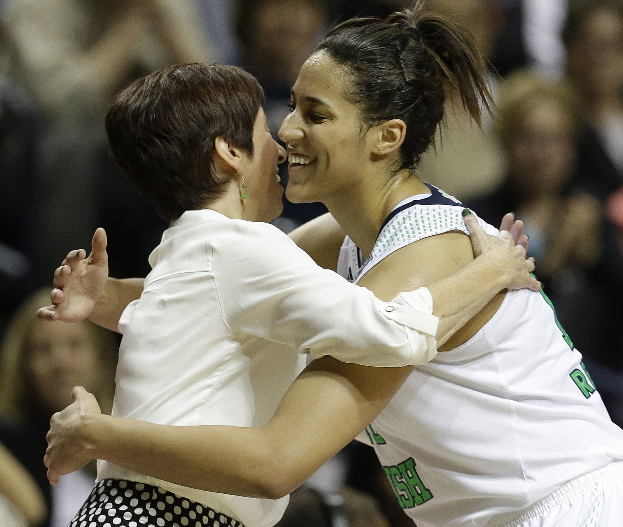 Notre Dame forward Taya Reimer embraces Notre Dame head coach Muffet McGraw during the second half of the semifinal game against Maryland in the Final Four of the NCAA women's college basketball tournament, Sunday, April 6, 2014, in Nashville, Tenn. Notre Dame won 87-61.