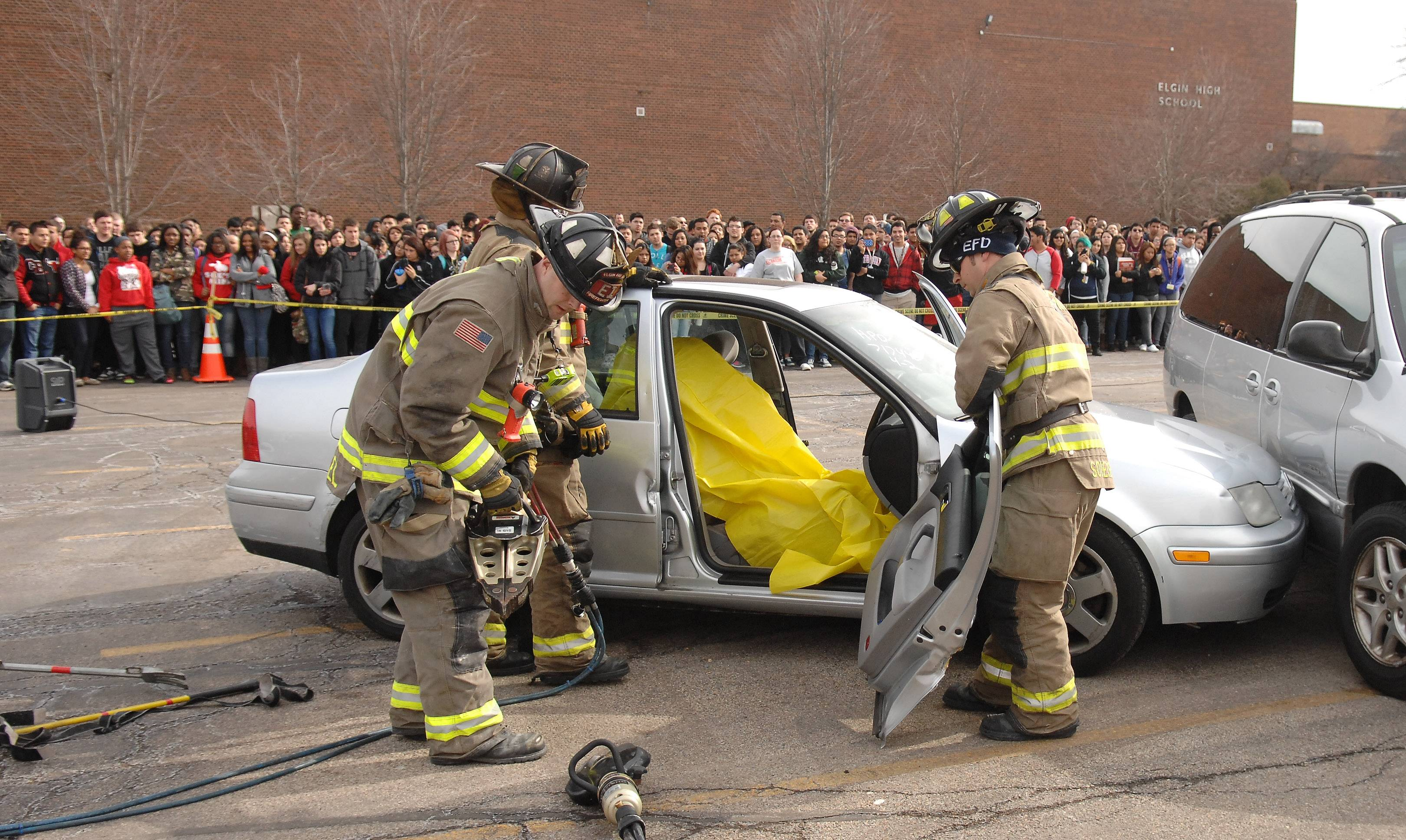 "Elgin firefighters extricate a ""patient"" as Elgin police re-create a fatal drunken driving crash during Operation Prom Night Monday at Elgin High School."