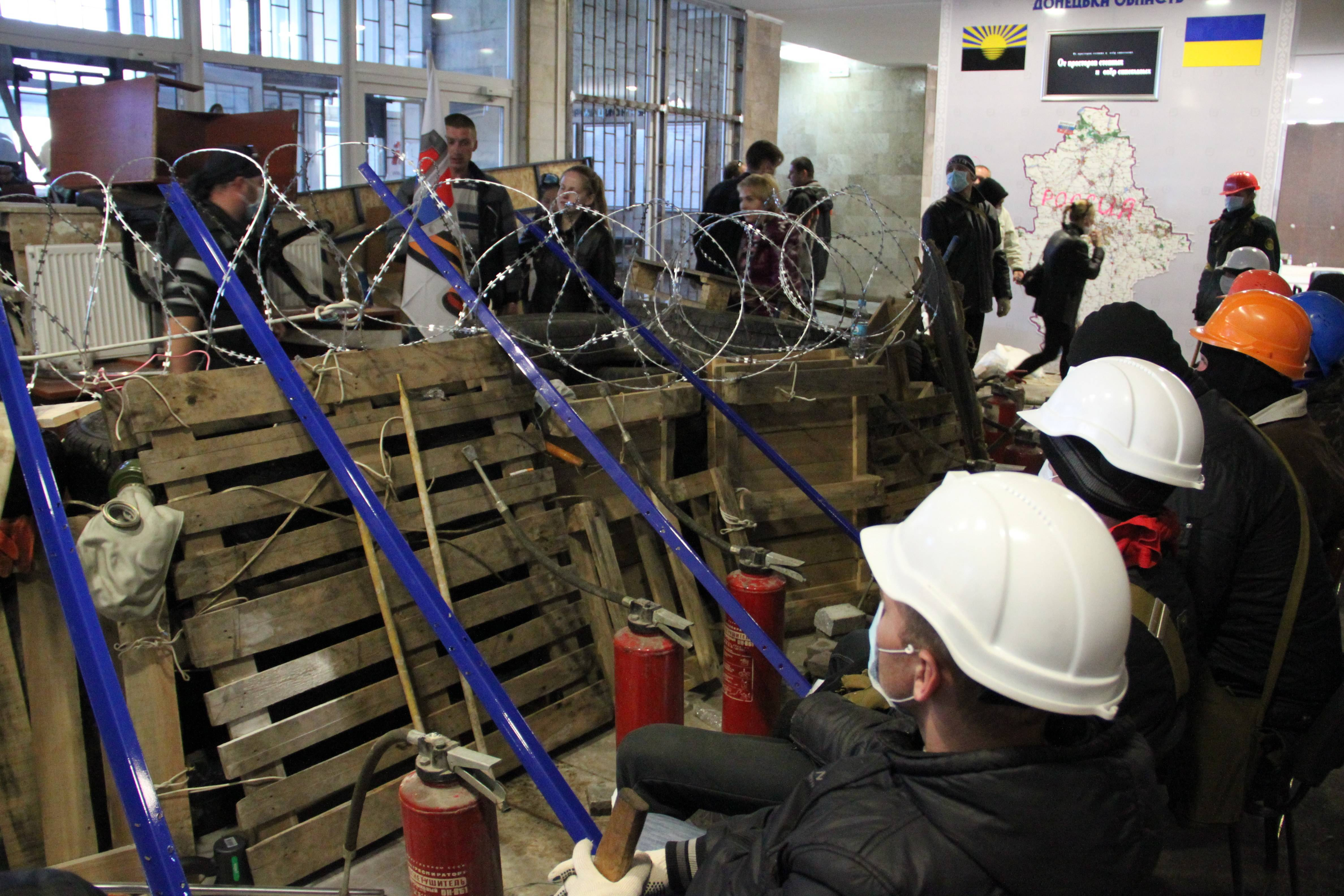 Activists prepare a barricade inside the regional administration building in Donetsk, Ukraine, Monday. A Ukrainian news agency is reporting pro-Russian separatists who have seized the regional administration building in the eastern Ukrainian city of Donetsk proclaimed the region an independent republic.
