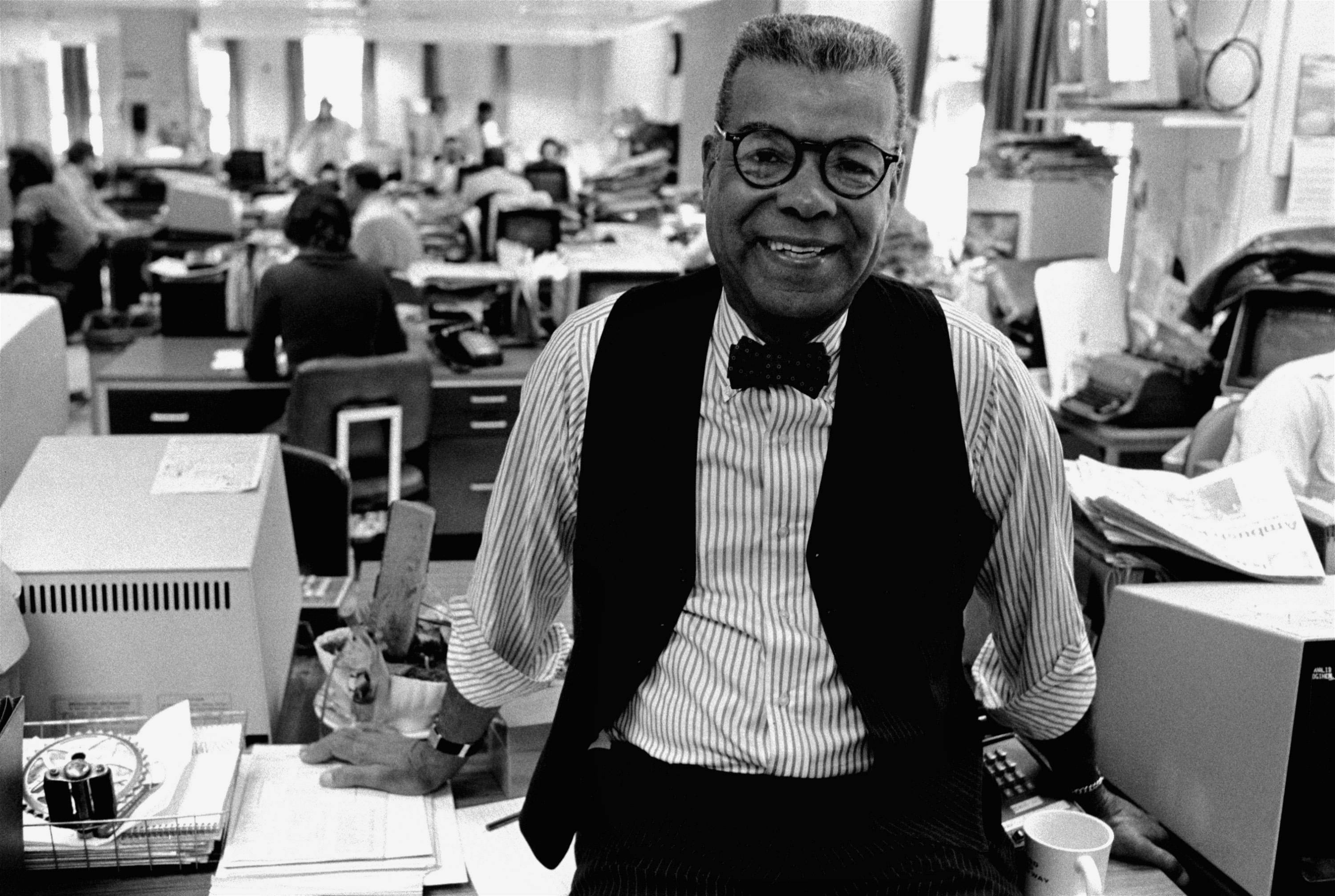 "In this Feb. 15, 1984, file photo, newspaper columnist Chuck Stone poses in the newsroom of the Daily News in Philadelphia. Longtime journalist and educator Charles Sumner ""Chuck"" Stone Jr., one of the founders of the National Association of Black Journalists, has died. He was 89. Allegra Stone said that her father died Sunday, April 6, 2014."